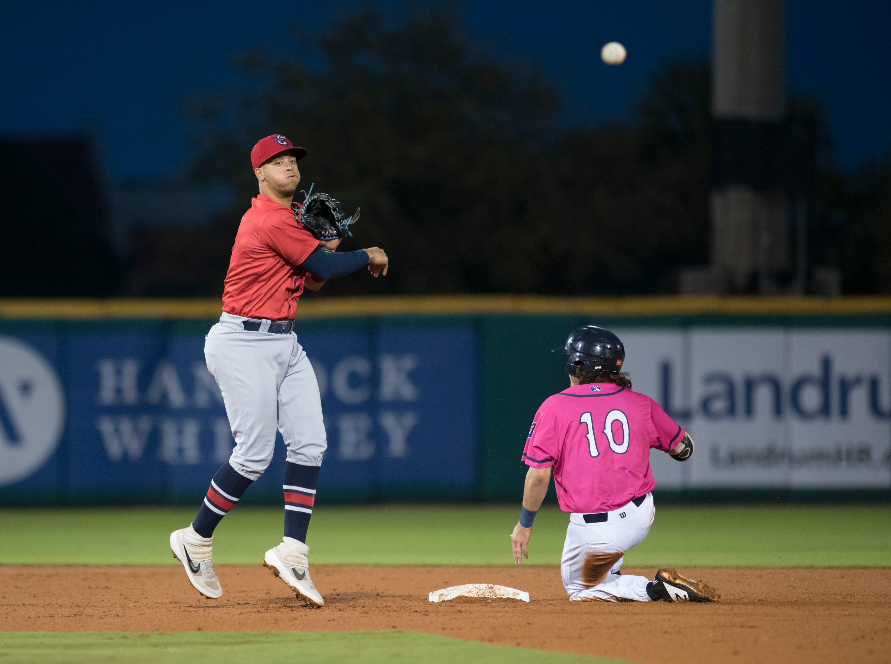 Shortstop Joe Dunand (3) turns the double play during the Jacksonville Jumbo Shrimp vs Pensacola Blue Wahoos baseball game in Pensacola on Friday, April 12, 2019.