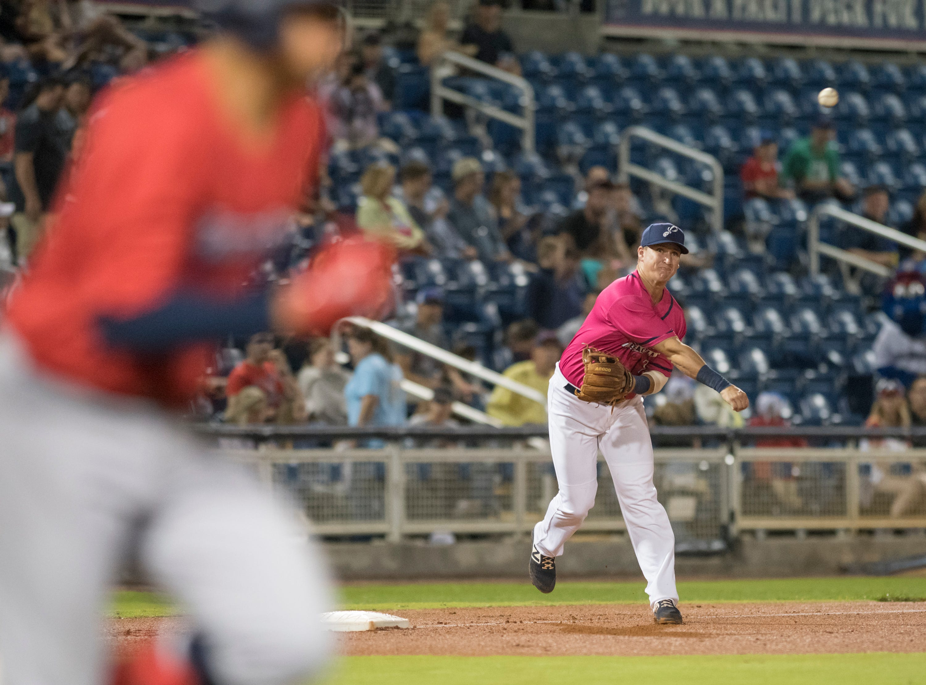 Third baseman Brian Schales (9) throws to first for an out during the Jacksonville Jumbo Shrimp vs Pensacola Blue Wahoos baseball game in Pensacola on Friday, April 12, 2019.
