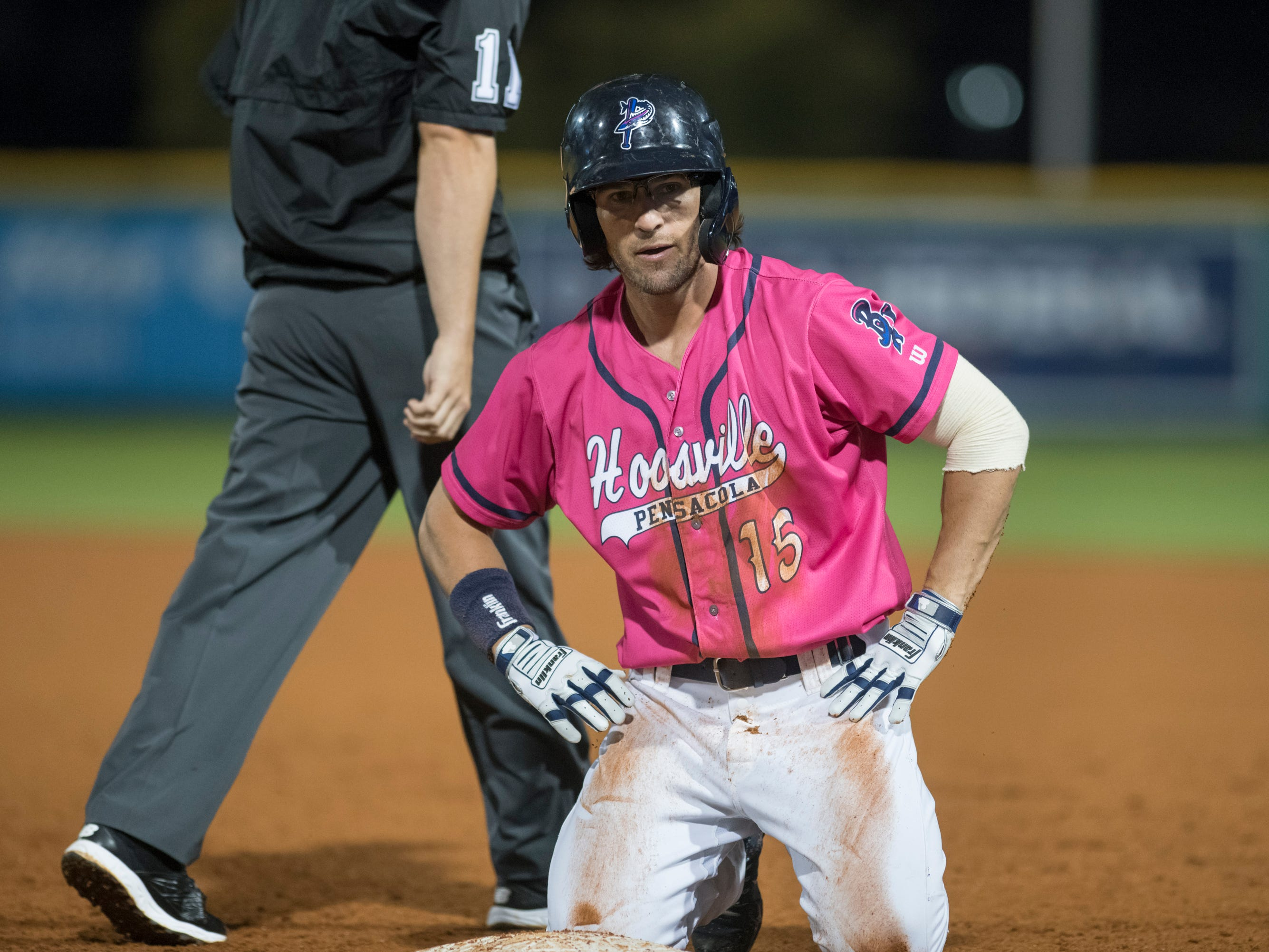 Drew Maggi (15) reacts to getting caught on too wide of a turn after singling to right field for the last out of the inning during the Jacksonville Jumbo Shrimp vs Pensacola Blue Wahoos baseball game in Pensacola on Friday, April 12, 2019.