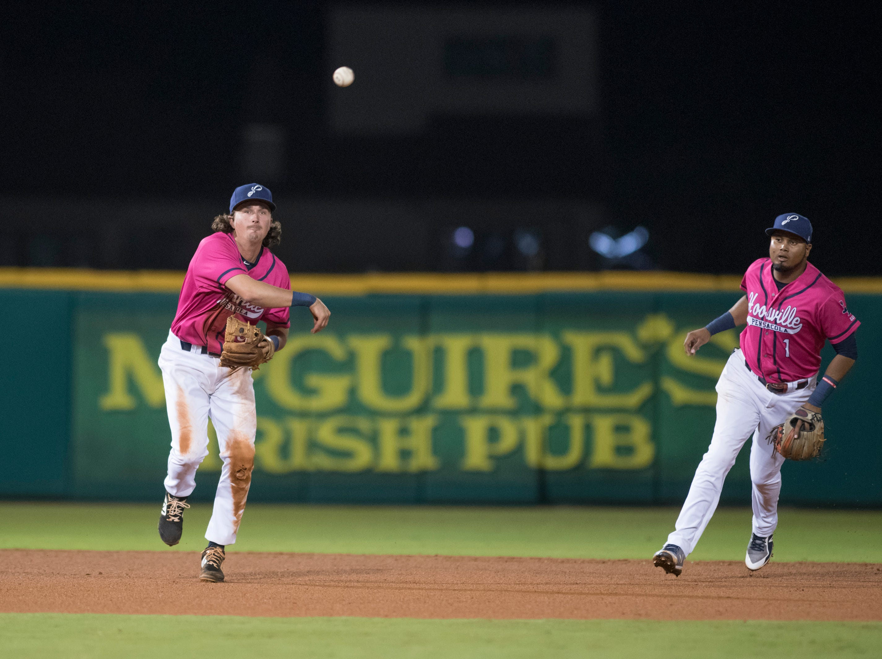 Shortstop Jordan Gore (10) throws to first for an out during the Jacksonville Jumbo Shrimp vs Pensacola Blue Wahoos baseball game in Pensacola on Friday, April 12, 2019.
