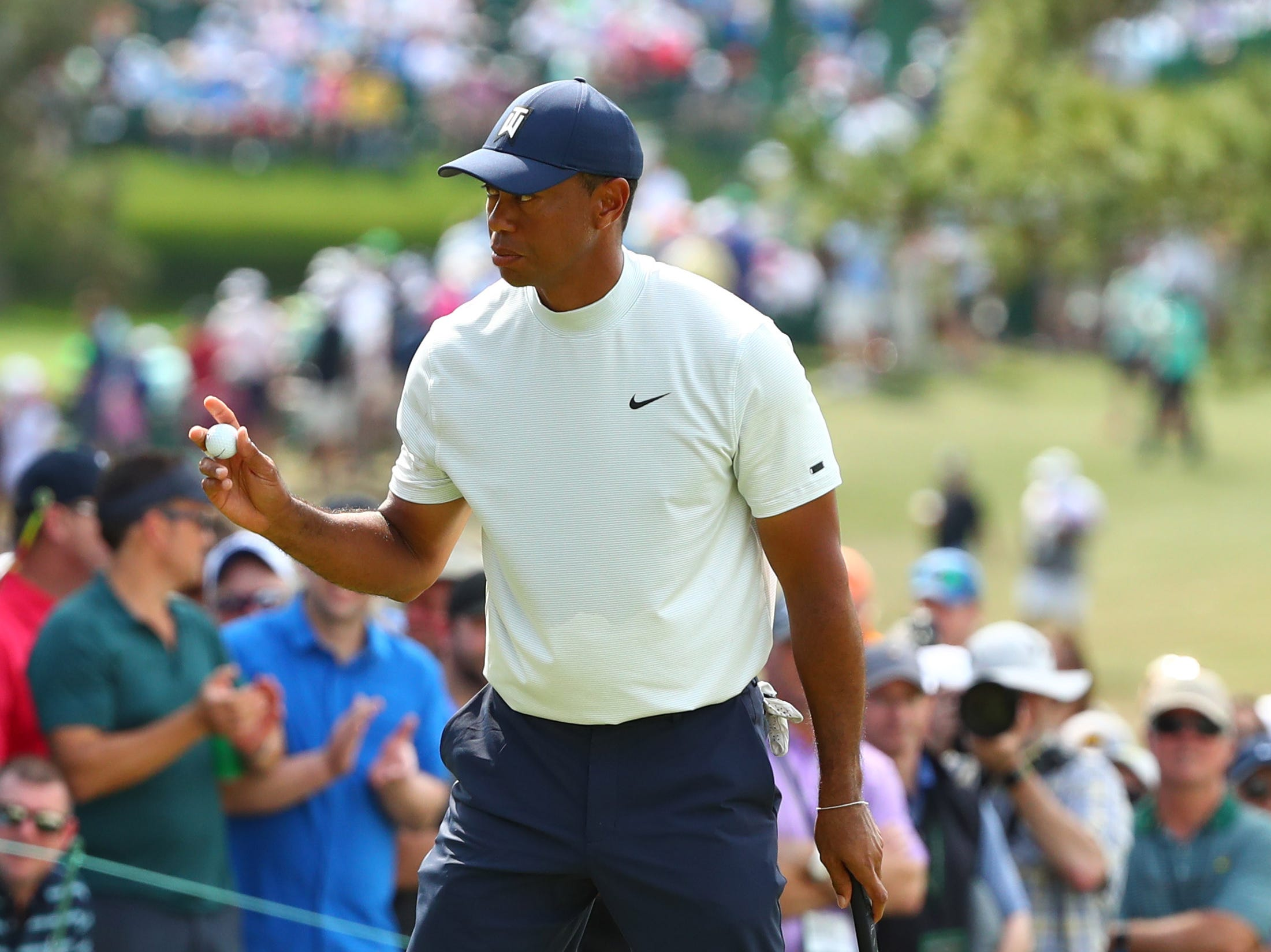 Apr 12, 2019; Augusta, GA, USA; Tiger Woods after putting on the 7th green during the second round of The Masters golf tournament at Augusta National Golf Club. Mandatory Credit: Rob Schumacher-USA TODAY Sports