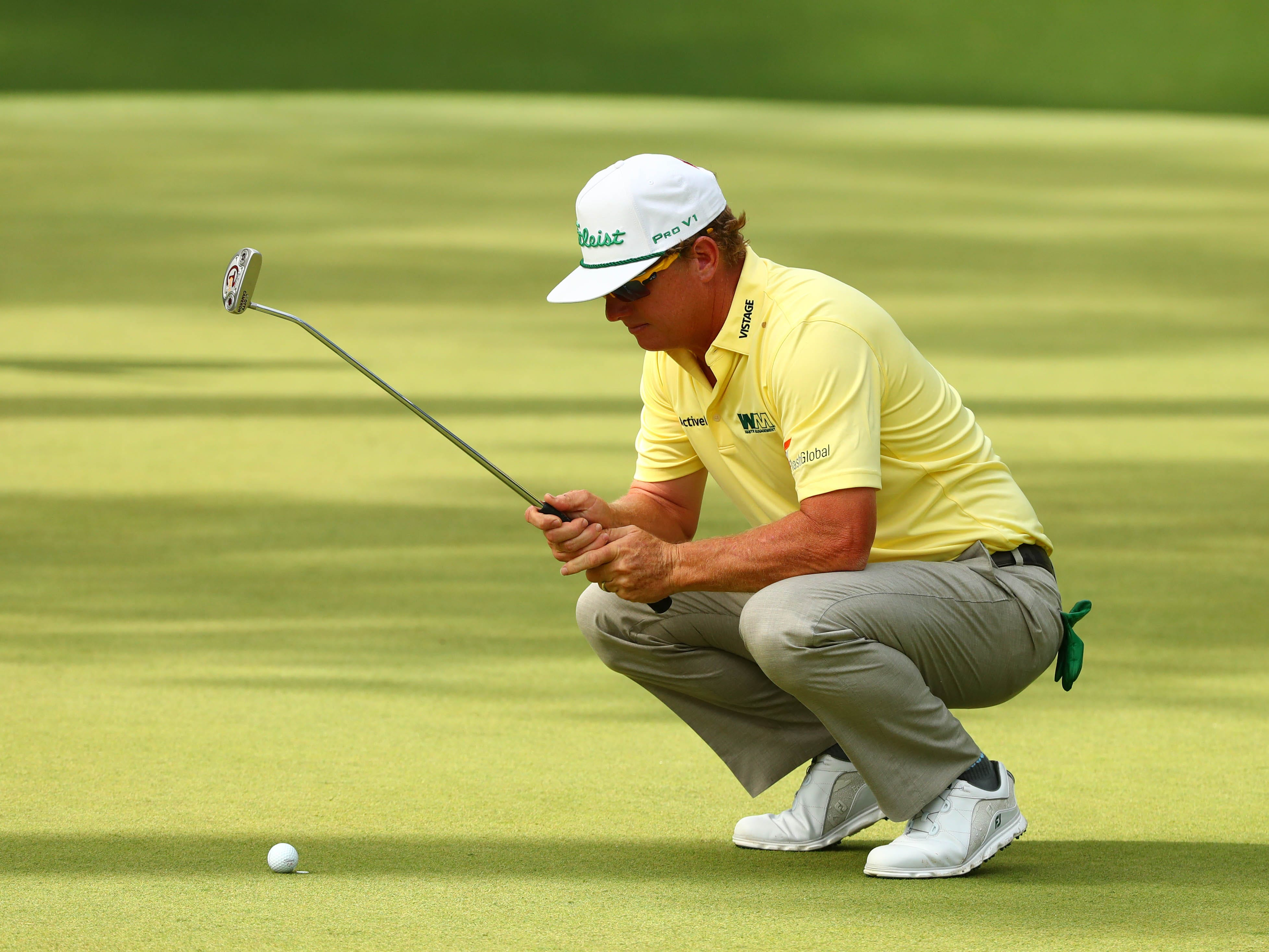 Apr 12, 2019; Augusta, GA, USA; Charley Hoffman lines up a putt on the 10th green during the second round of The Masters golf tournament at Augusta National Golf Club. Mandatory Credit: Rob Schumacher-USA TODAY Sports