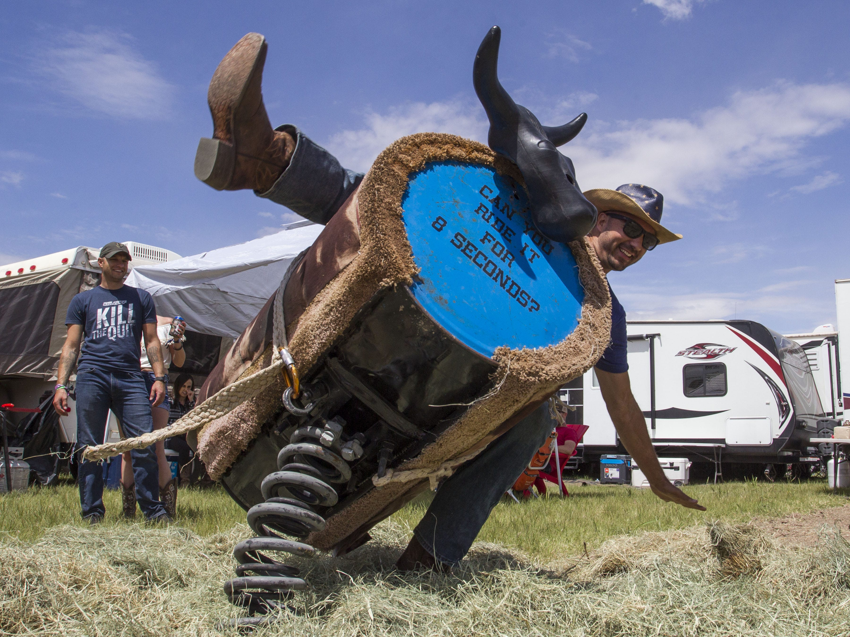 Daniel Valencia flies off the bull at I Love This Camp during Country Thunder Arizona Friday, April 12, 2019, in Florence, Ariz.
