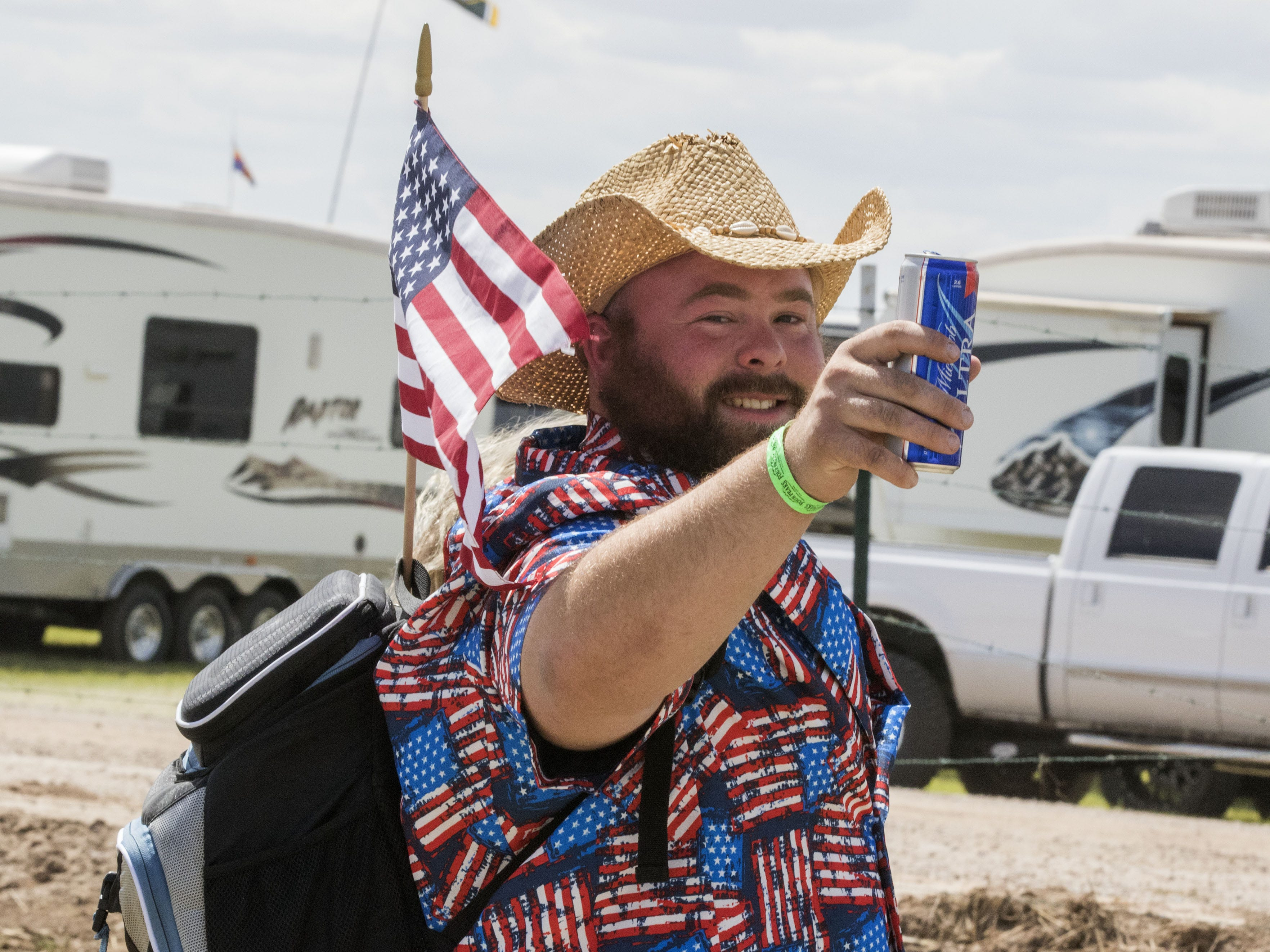 A party goer salutes the public with a beer during Country Thunder Arizona Friday, April 12, 2019, in Florence, Arizona.