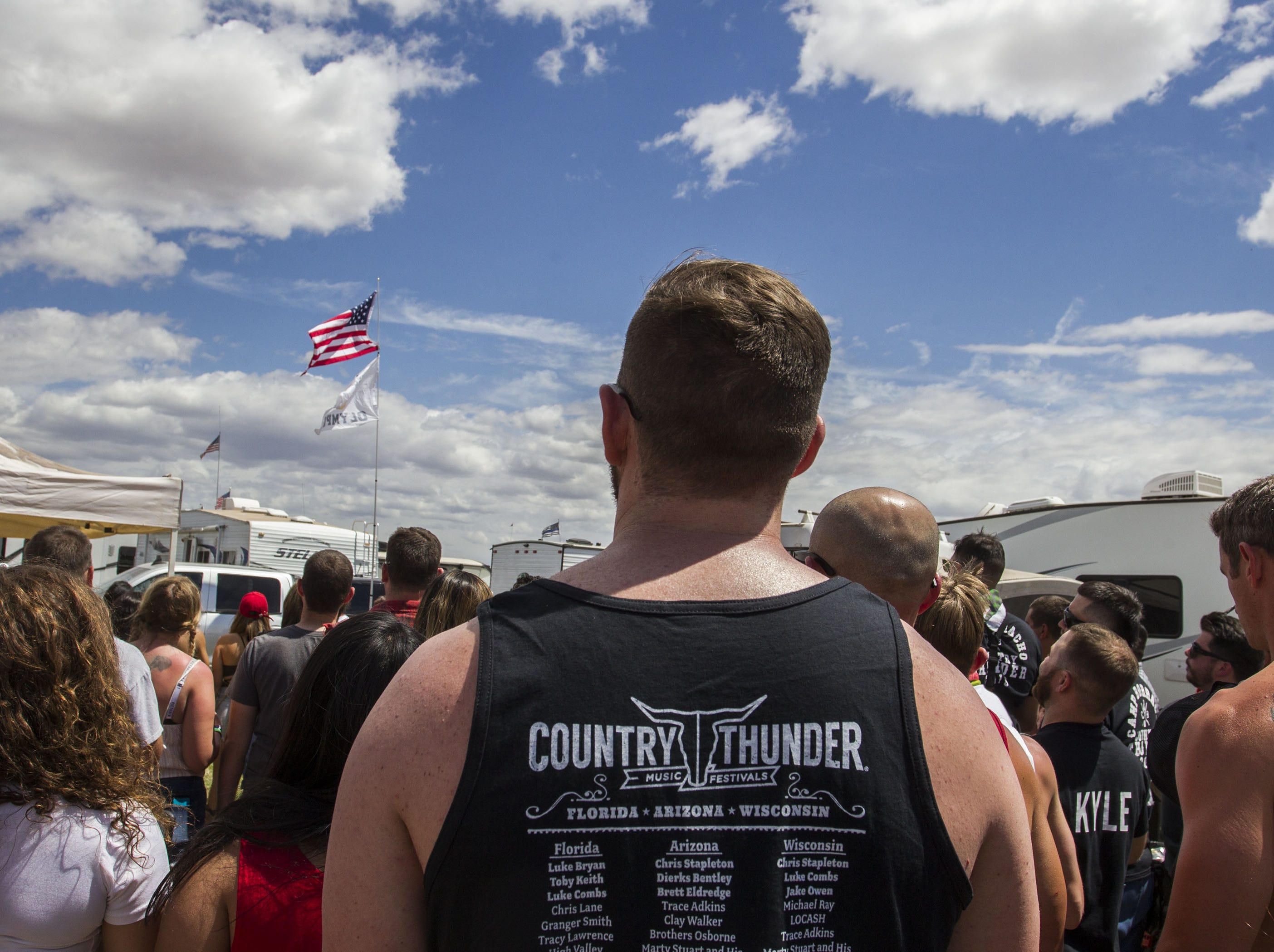 Beer Olympic participates stand for the National Anthem before their games at Country Thunder Arizona Friday, April 12, 2019, in Florence, Arizona.