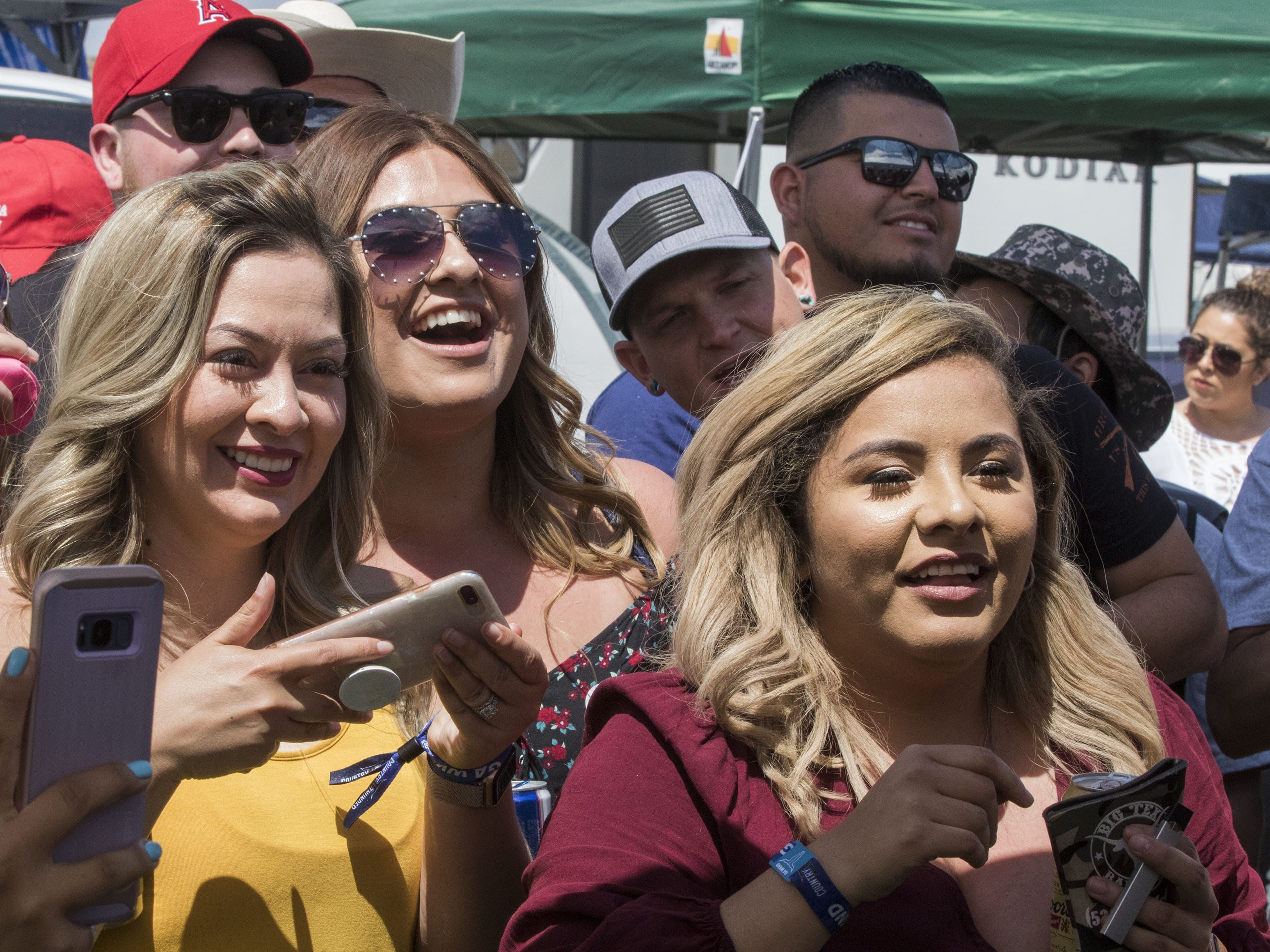 Fans cheer during the beer chugging game at Country Thunder Arizona Friday, April 12, 2019, in Florence, Ariz.