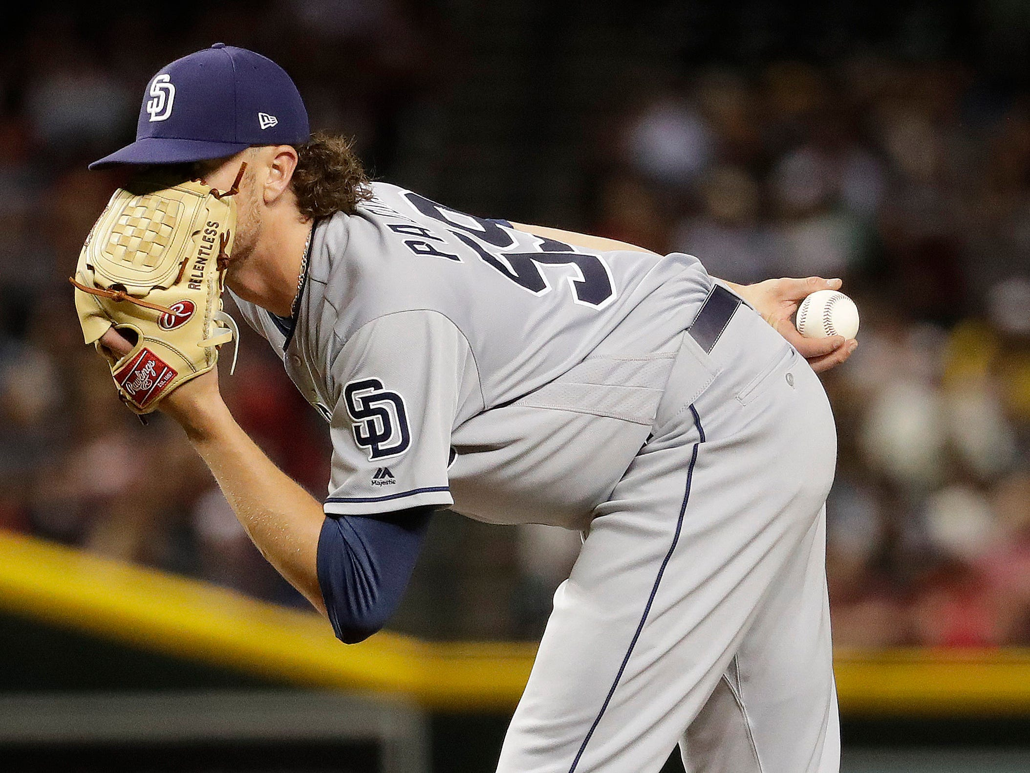 San Diego Padres starting pitcher Chris Paddack looks for the sign during the third inning of a baseball game against the Arizona Diamondbacks, Friday, April 12, 2019, in Phoenix. (AP Photo/Matt York)
