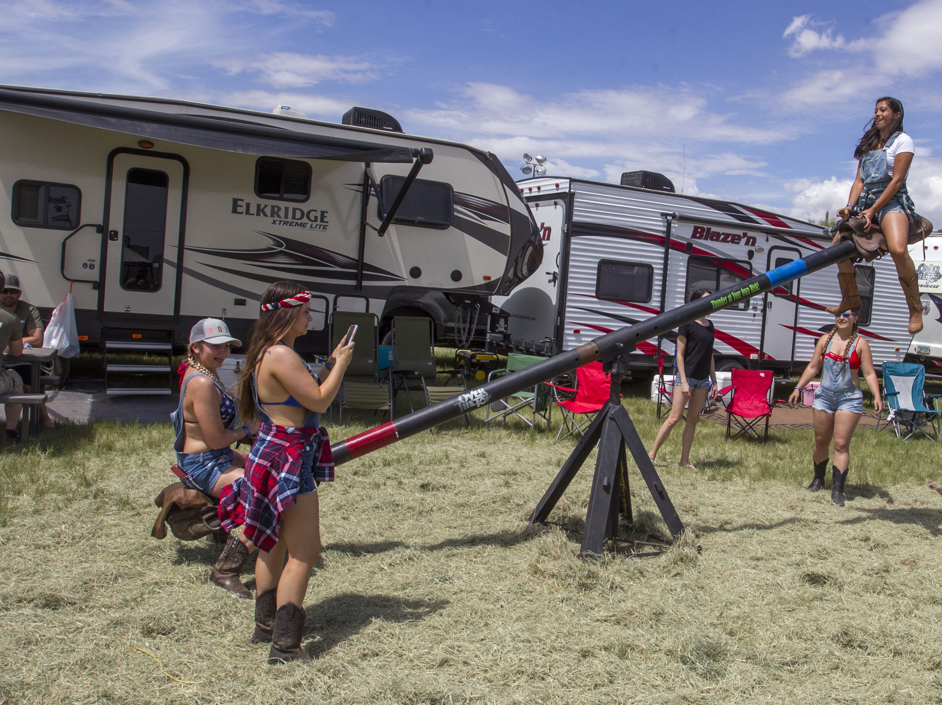 Laura Blackwell (left) and Paulette Mordini do teeter totter at I Love this Camp at Country Thunder Arizona Friday, April 12, 2019, in Florence, Arizona.