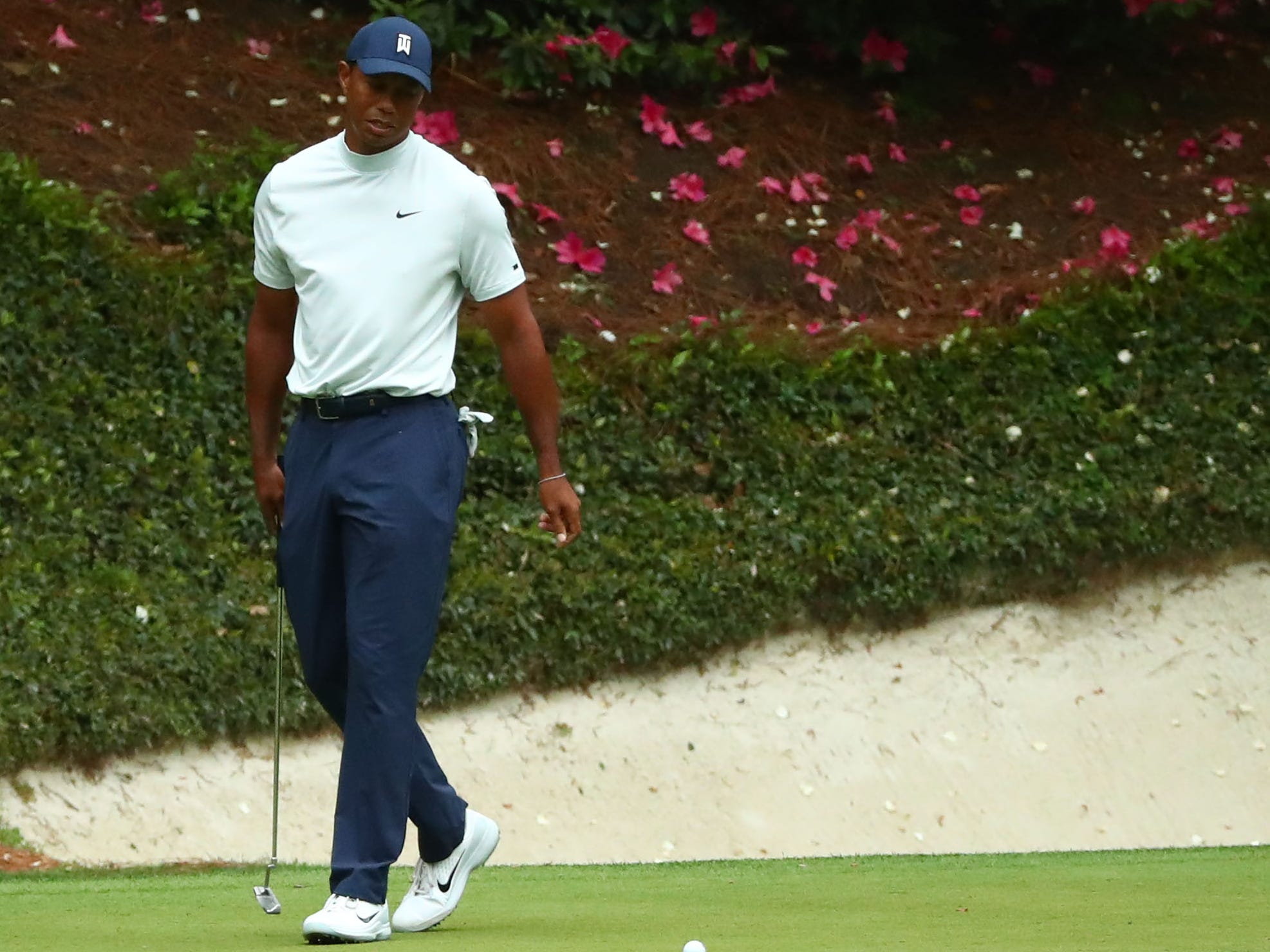Apr 12, 2019; Augusta, GA, USA; Tiger Woods reacts after missing a putt on the 12th green during the second round of The Masters golf tournament at Augusta National Golf Club. Mandatory Credit: Rob Schumacher-USA TODAY Sports