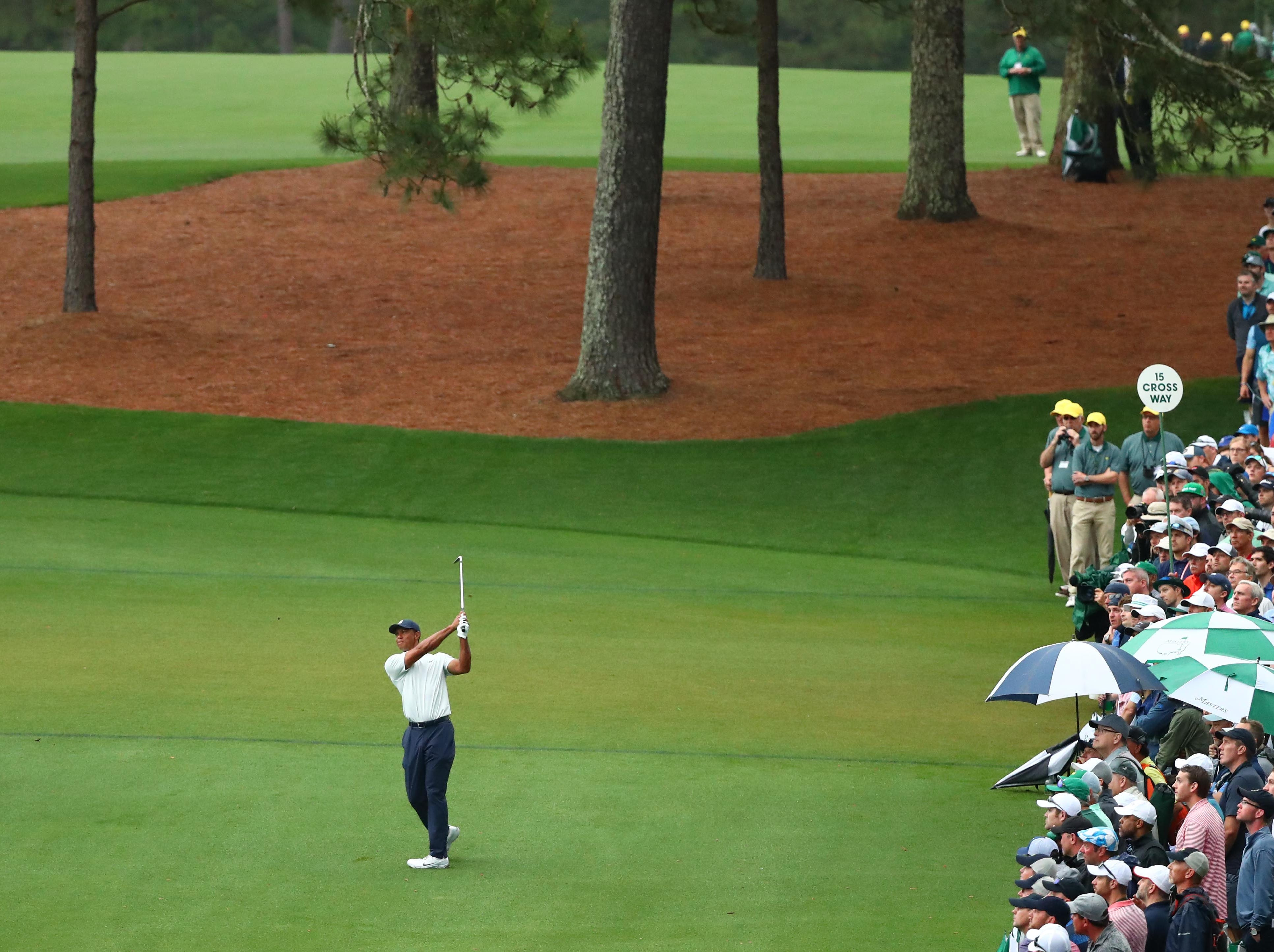 Apr 12, 2019; Augusta, GA, USA; Tiger Woods hits from the fairway on the 15th hole during the second round of The Masters golf tournament at Augusta National Golf Club. Mandatory Credit: Rob Schumacher-USA TODAY Sports