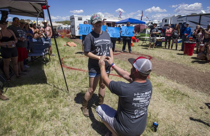 Tahnee Billingsly gets a ring and marriage proposal Justin Adams as he surprises her with a proposal surrounded by family and friends during Country Thunder Arizona Saturday, April 13, 2019, in Florence, Ariz.