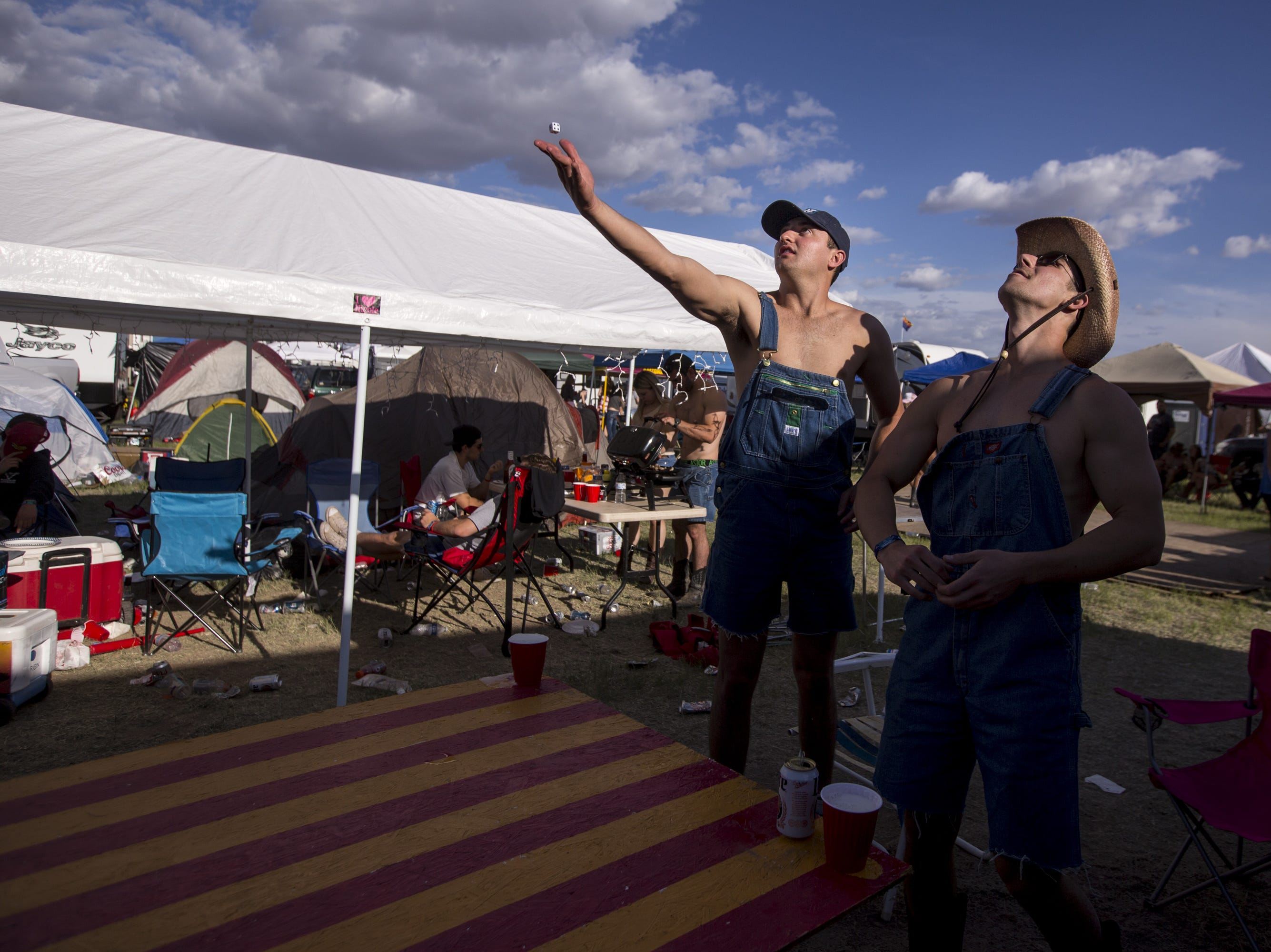 Joey Padish (left) and Zach Ondrejka play beer die on Friday, April 12, 2019, during Day 2 of Country Thunder Arizona in Florence, Ariz.