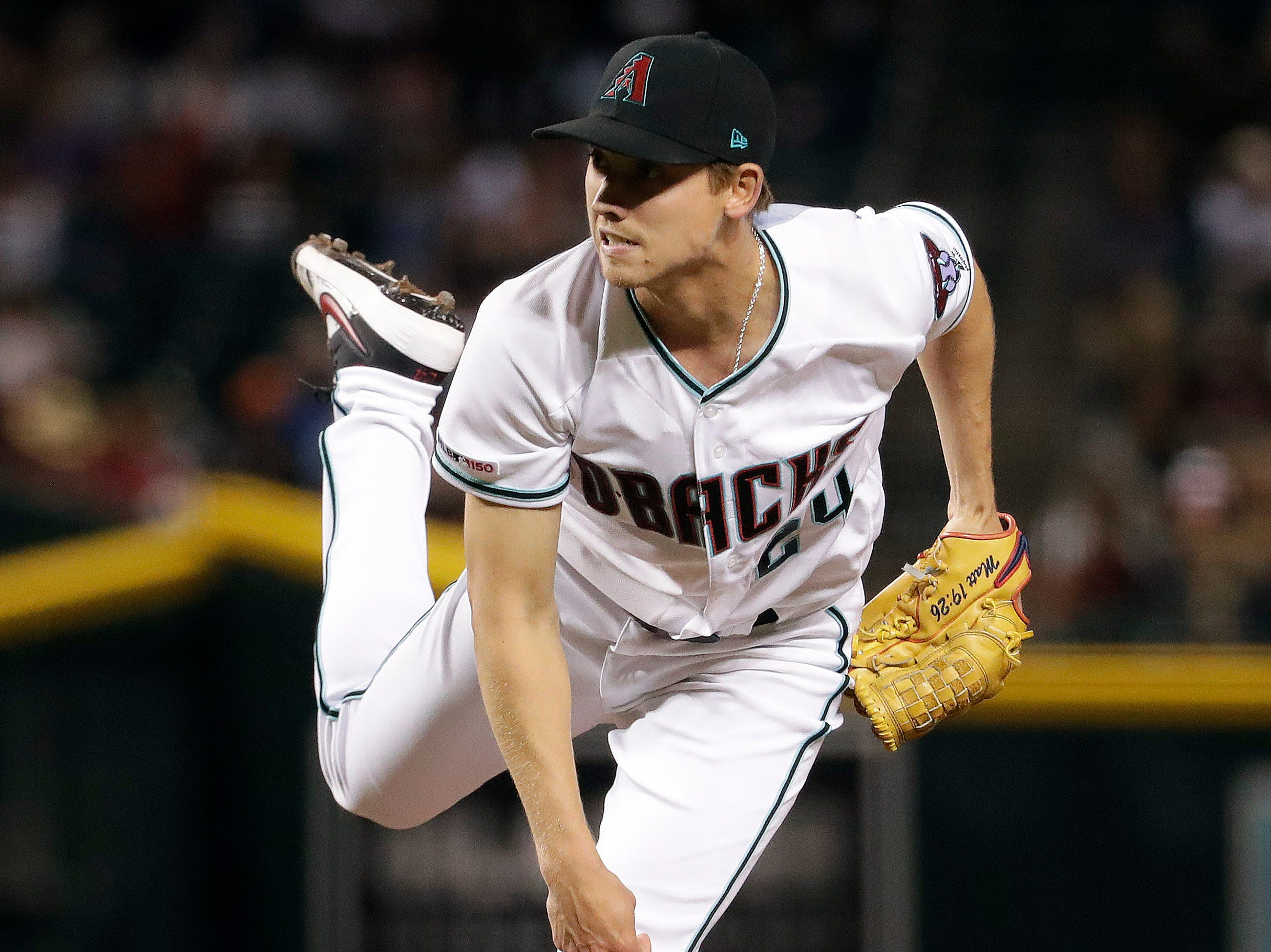 Arizona Diamondbacks starting pitcher Luke Weaver watches a throw to the San Diego Padres during the seventh inning of a baseball game Friday, April 12, 2019, in Phoenix. (AP Photo/Matt York)