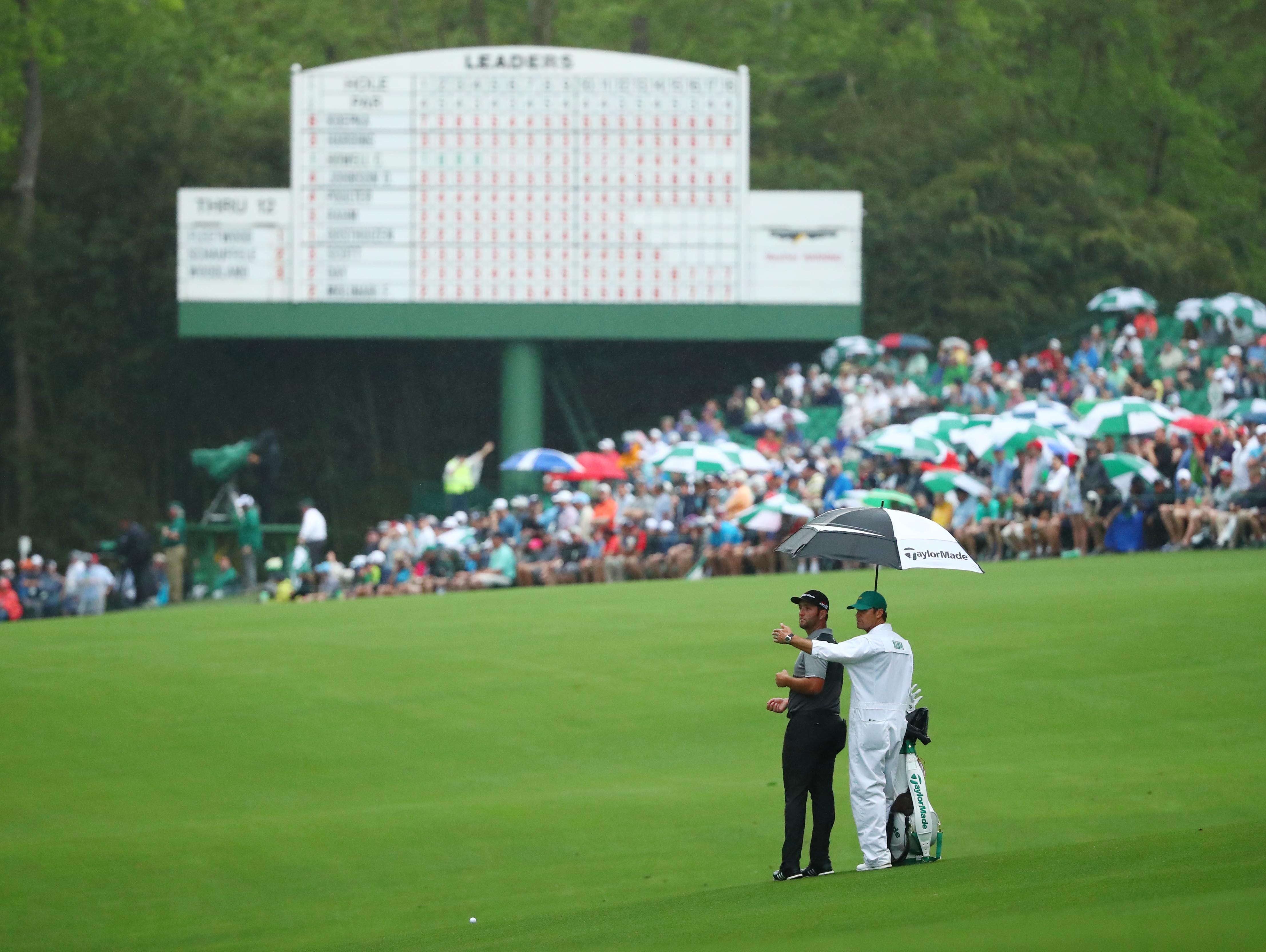 Apr 12, 2019; Augusta, GA, USA; Jon Rahm and caddie Adam Hayes in the 13th fairway during the second round of The Masters golf tournament at Augusta National Golf Club. Mandatory Credit: Rob Schumacher-USA TODAY Sports