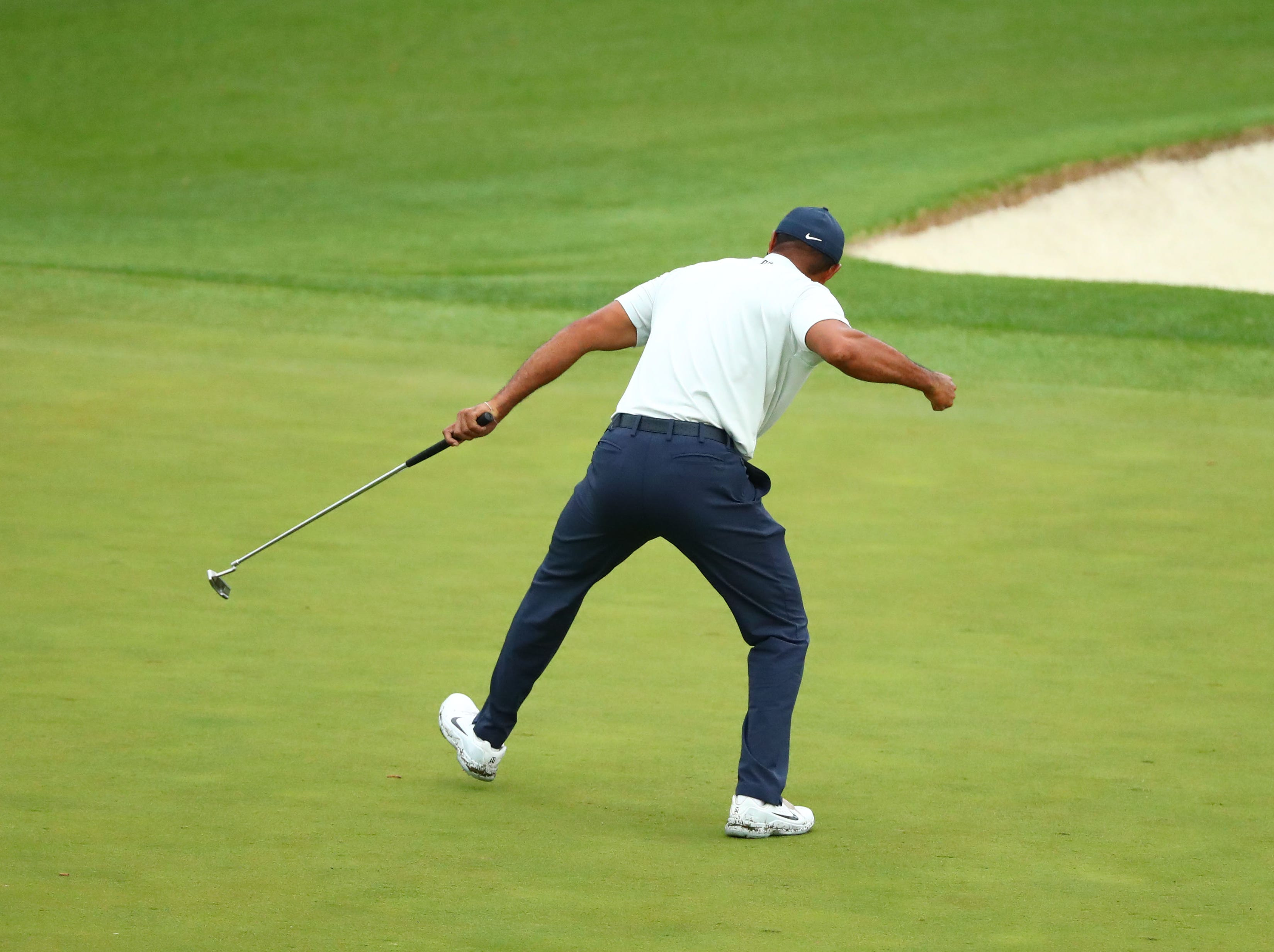 Apr 12, 2019; Augusta, GA, USA; Tiger Woods reacts after making a birdie putt on the 15th green during the second round of The Masters golf tournament at Augusta National Golf Club. Mandatory Credit: Rob Schumacher-USA TODAY Sports