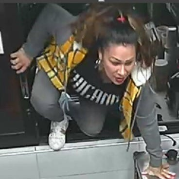 Police searching for woman who climbed through McDonald's drive-thru window