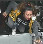 A woman climbed through the drive-thru window of a McDonalds in Phoenix before attacking an employee and taking food without paying, police say.