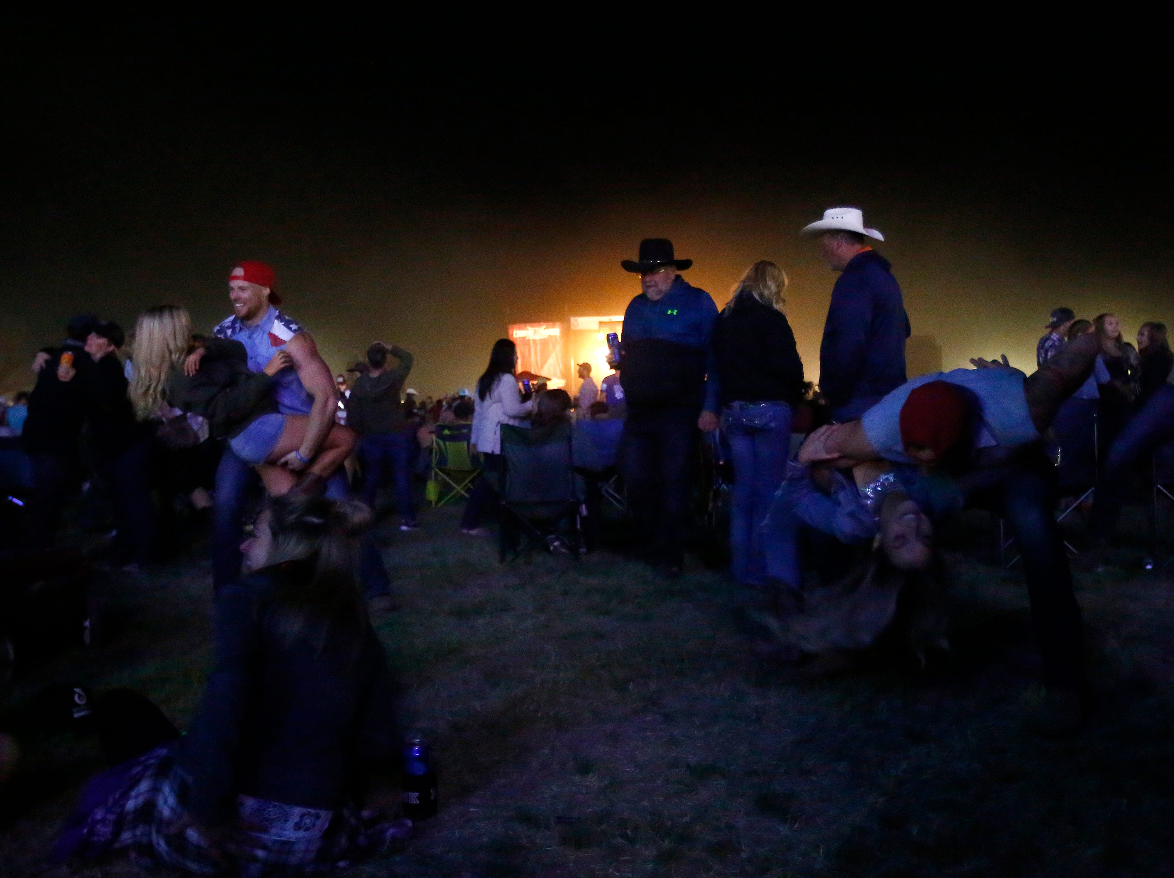 Country fans listen to Tim McGraw as he performs the Main Stage during Country Thunder in Florence, Ariz. on Friday, April 12, 2019.