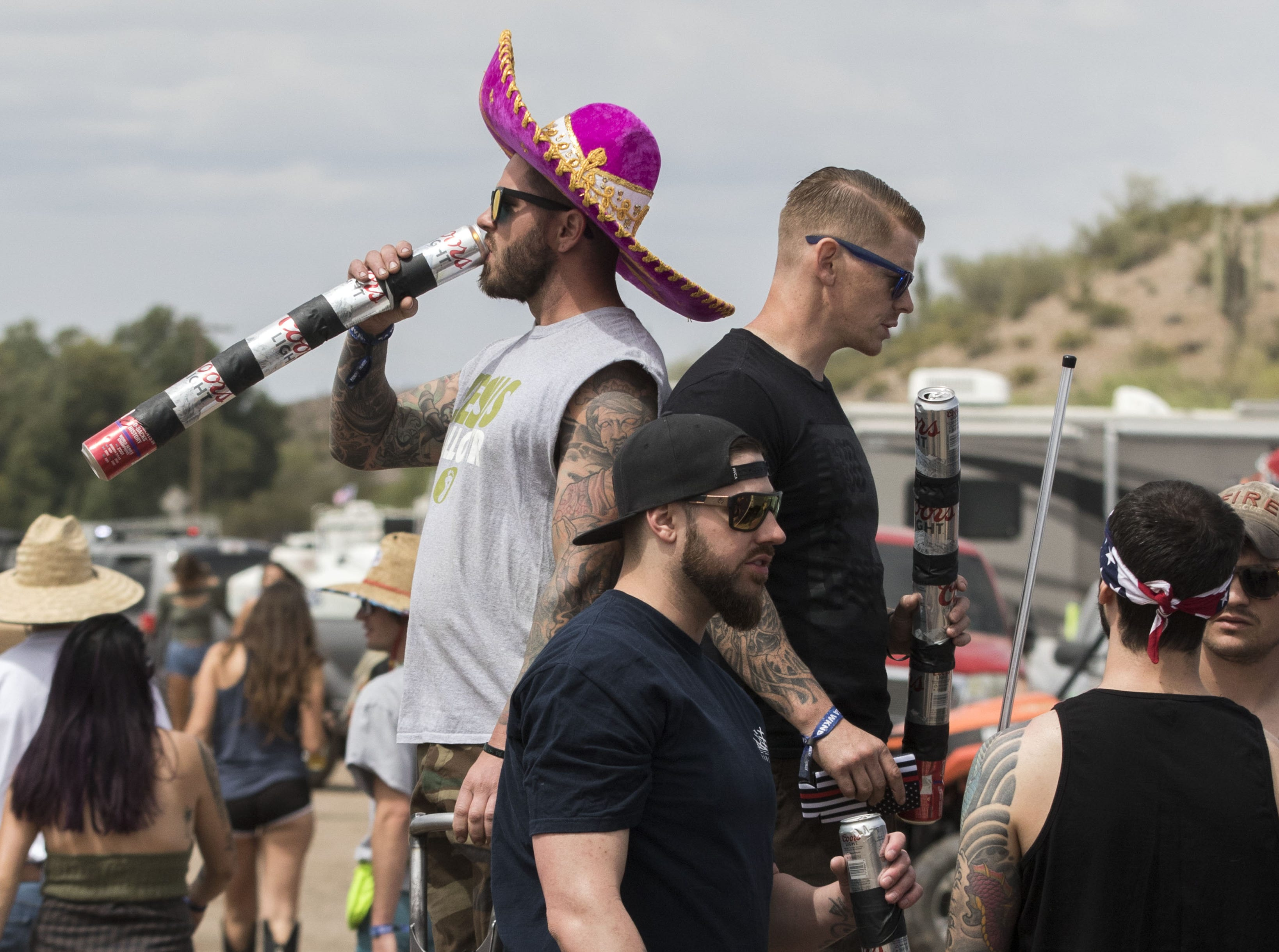 Joe Taylor of Las Vegas enjoys one of his five beers during Country Thunder Arizona Friday, April 12, 2019, in Florence, Arizona.