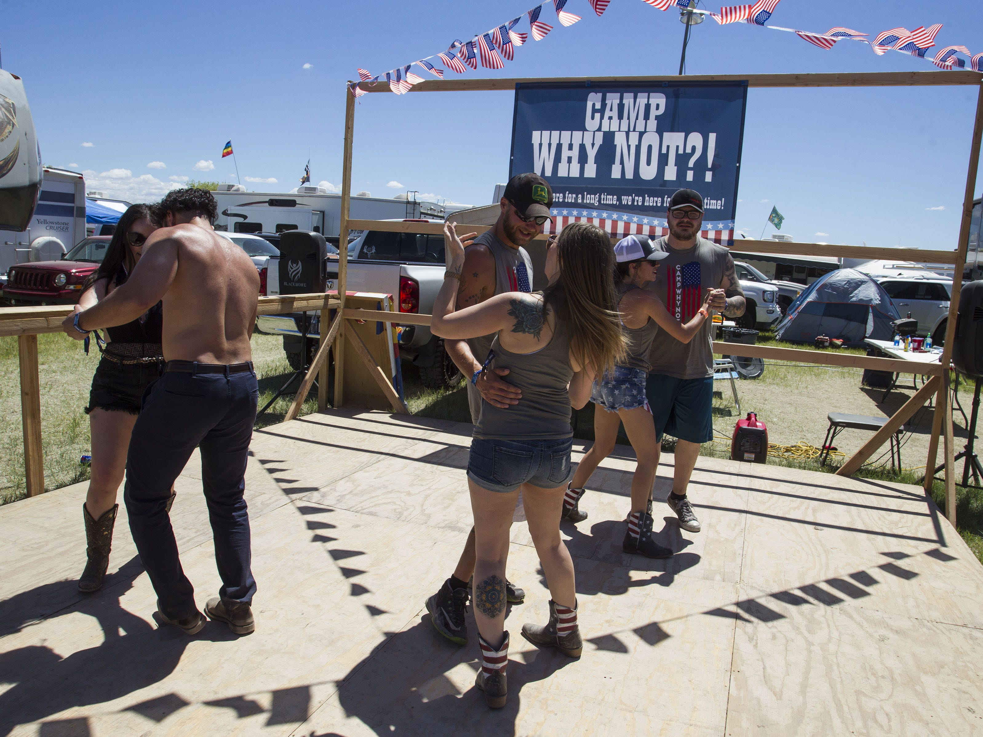 People share the dance floor at Camp Why Not during Country Thunder Arizona Saturday, April 13, 2019, in Florence, Ariz.