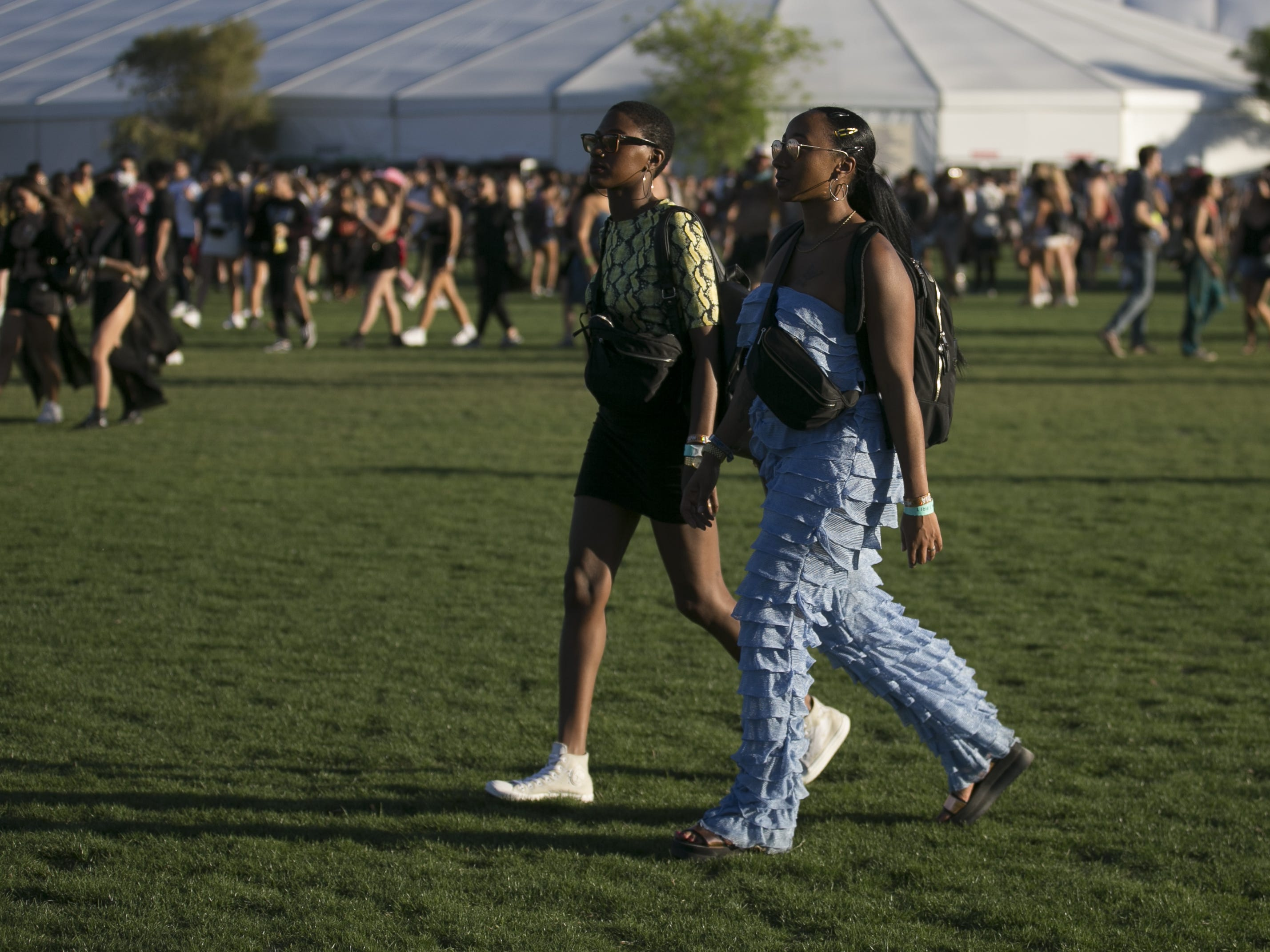 Festival-goers walk through the grounds at the Coachella Valley Music and Arts Festival in Indio, Calif. on April 12, 2019.