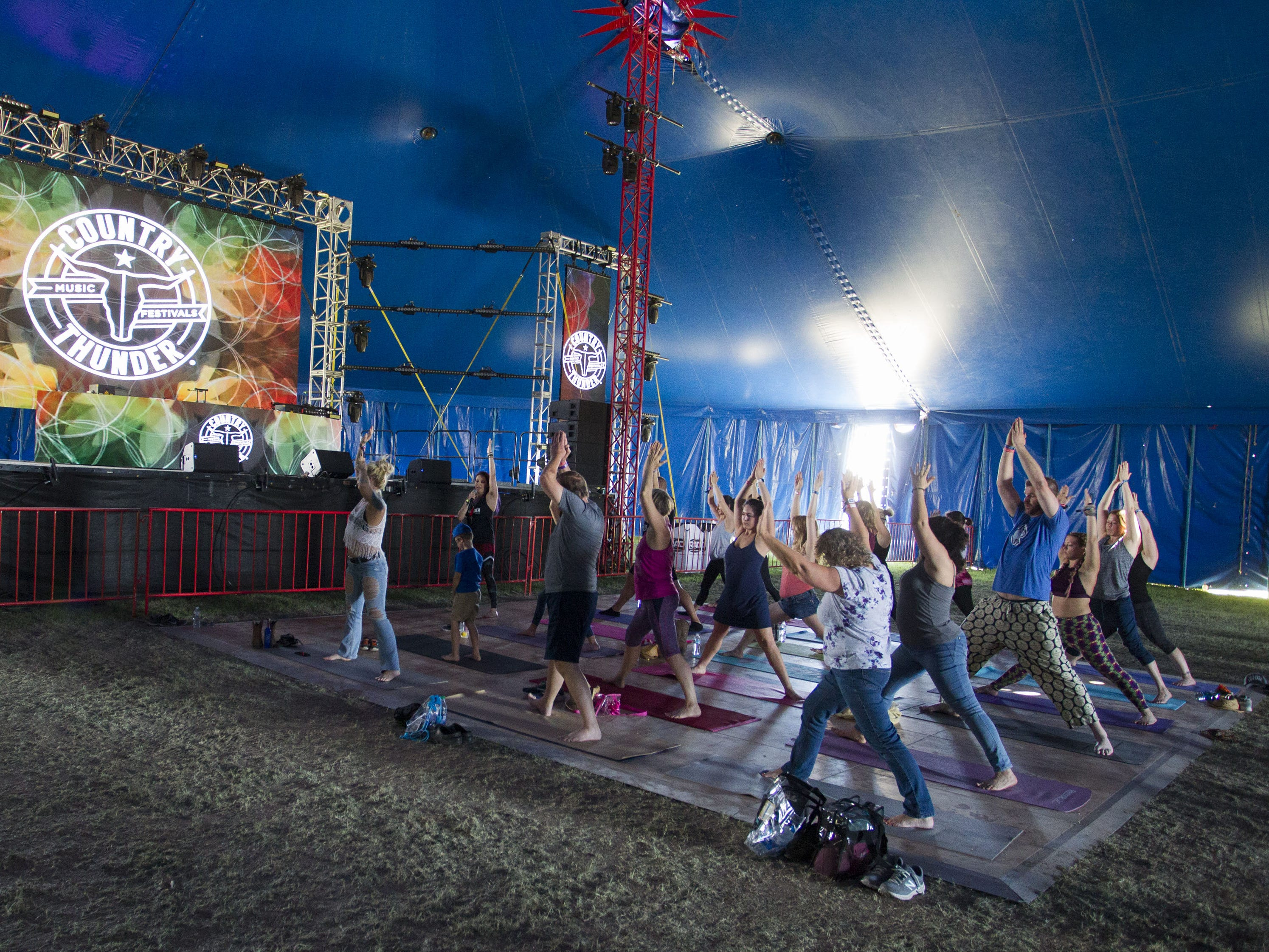 Festival-goers practice yoga during a session at Country Thunder Arizona Saturday, April 13, 2019, in Florence, Ariz.