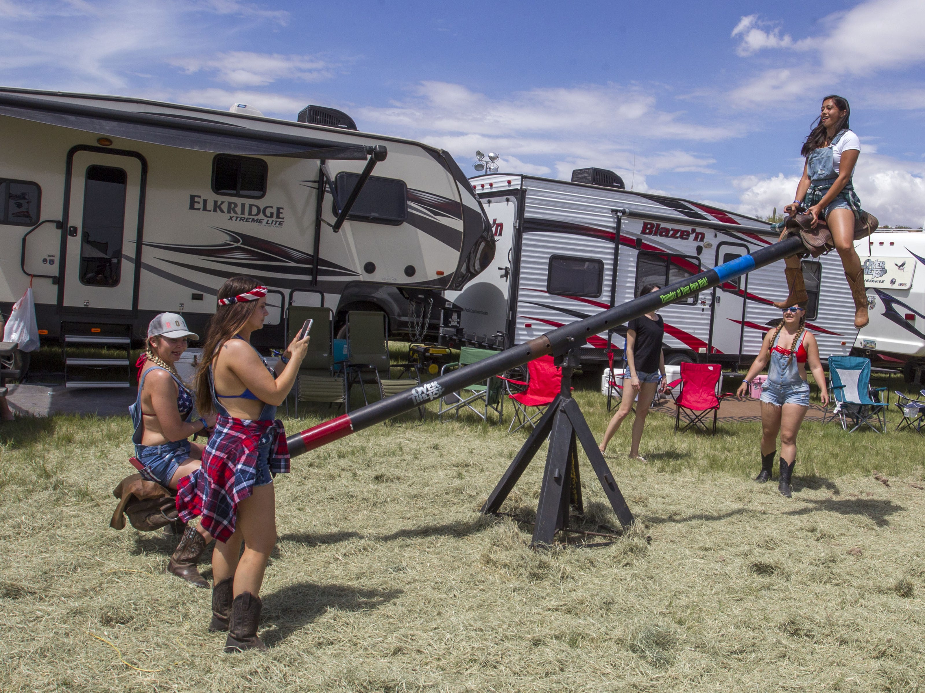 Laura Blackwell (left) and Paulette Mordini teeter totter at I Love This Camp at Country Thunder Arizona Friday, April 12, 2019, in Florence, Ariz.