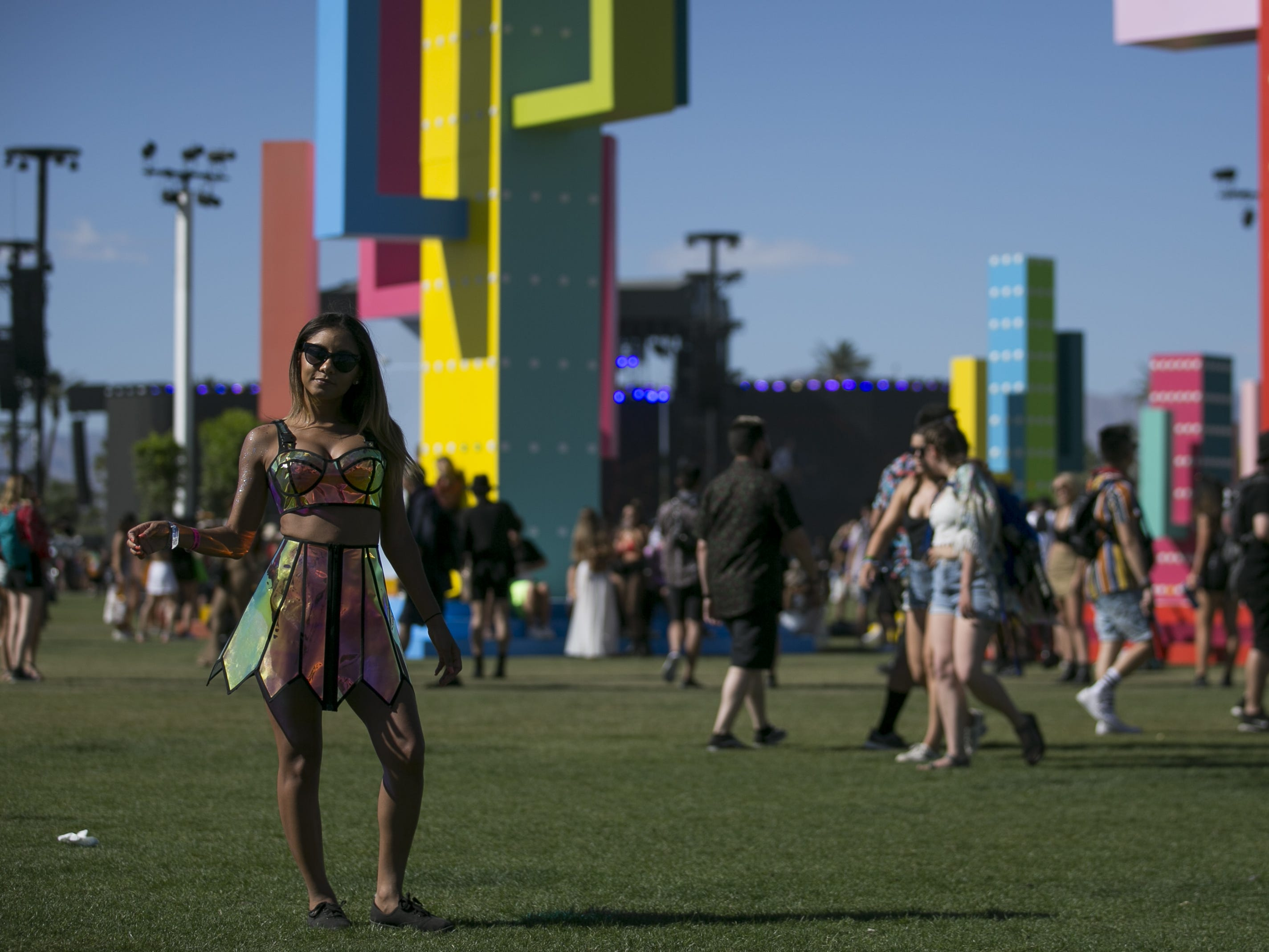 Mesly Casado, from Denver, poses in front of art installations at the Coachella Valley Music and Arts Festival in Indio, Calif. on April 12, 2019.