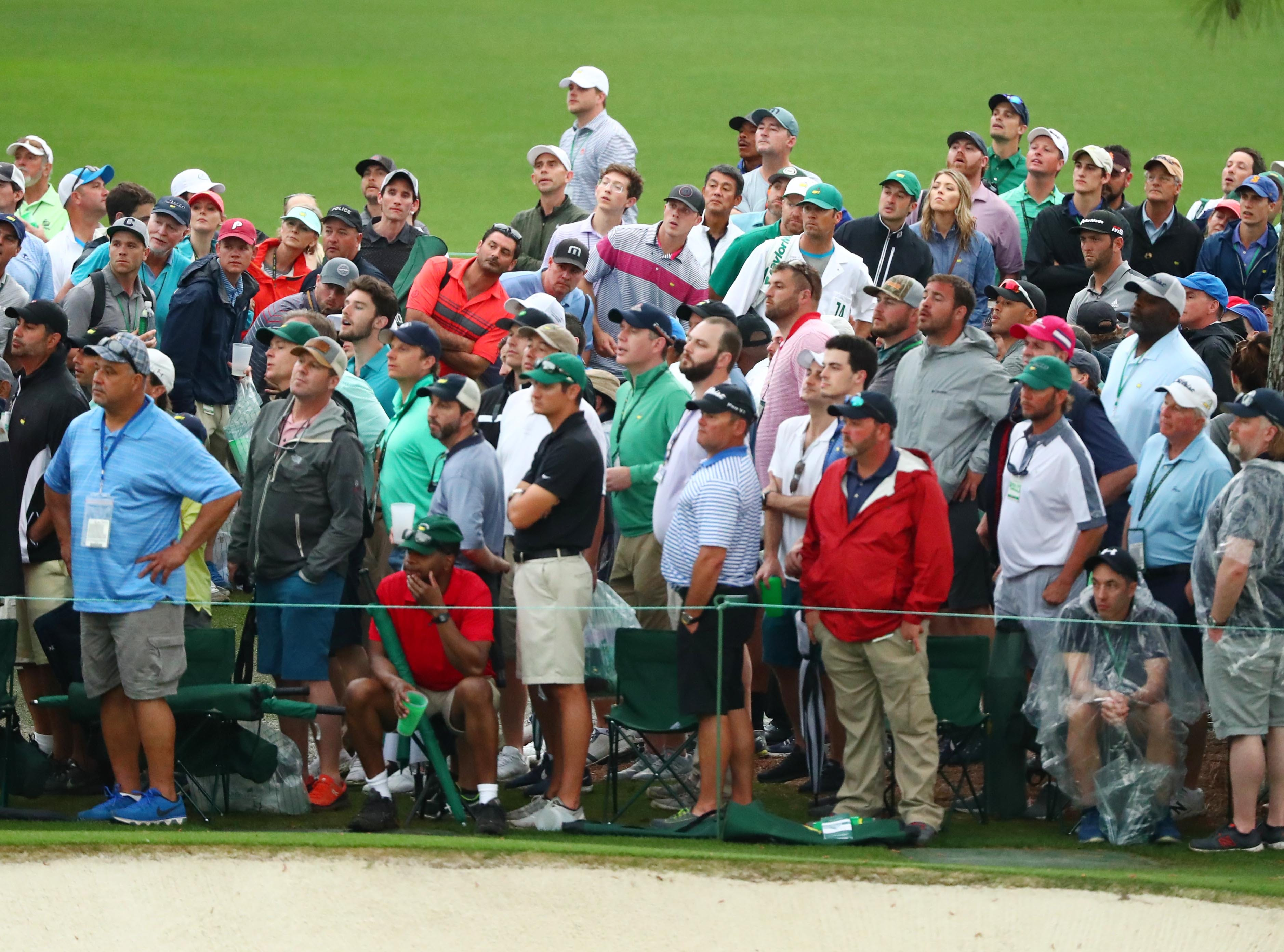 Apr 12, 2019; Augusta, GA, USA; Jon Rahm hits out of the gallery on the 15th hole during the second round of The Masters golf tournament at Augusta National Golf Club. Mandatory Credit: Rob Schumacher-USA TODAY Sports