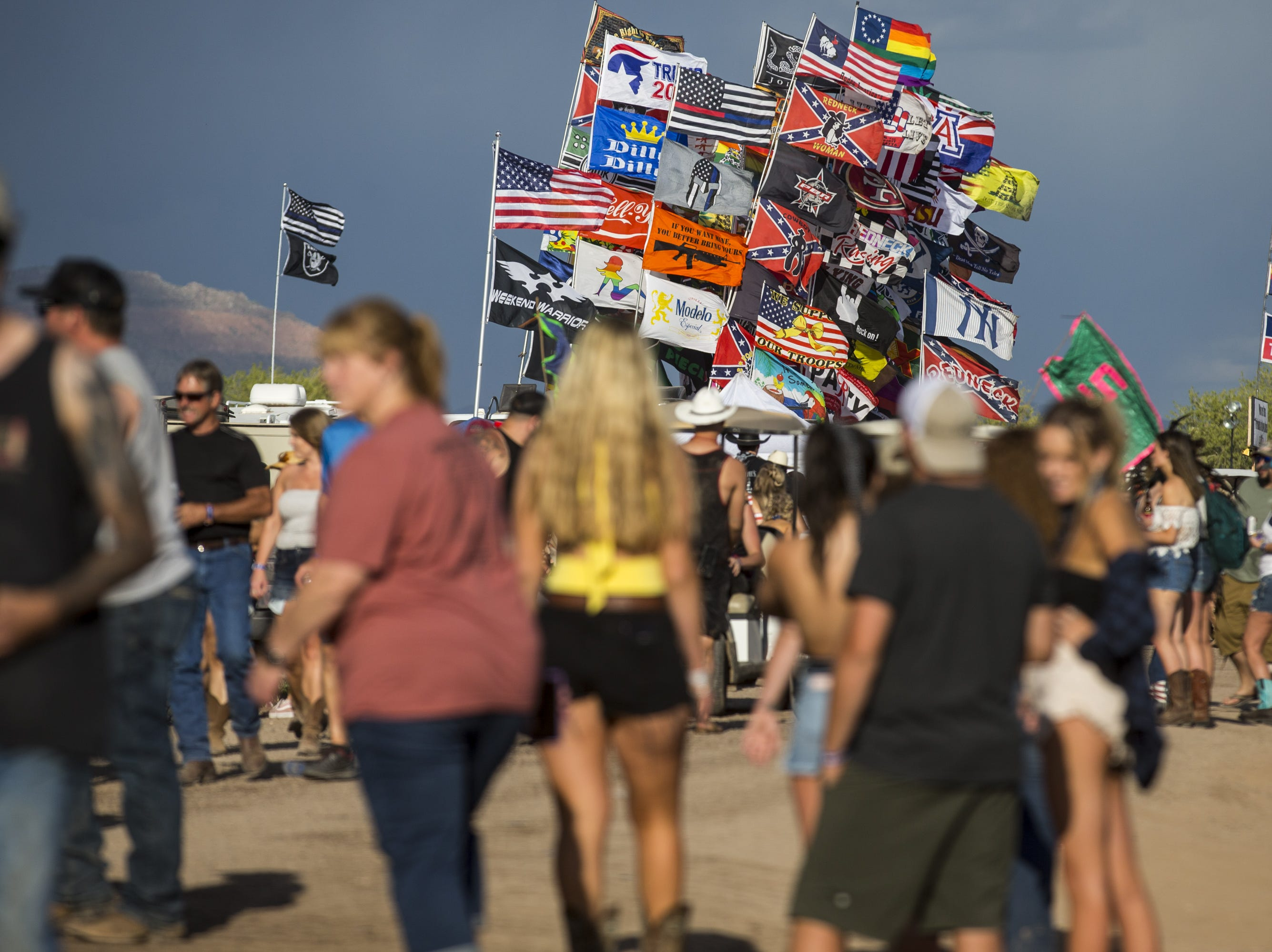 Flags are seen at the Crazy Coyote campground on Friday, April 12, 2019, during Day 2 of Country Thunder Arizona in Florence, Ariz.