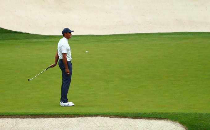 Apr 12, 2019; Augusta, GA, USA; Tiger Woods reacts after missing a birdie putt on the 16th green during the second round of The Masters golf tournament at Augusta National Golf Club. Mandatory Credit: Rob Schumacher-USA TODAY Sports