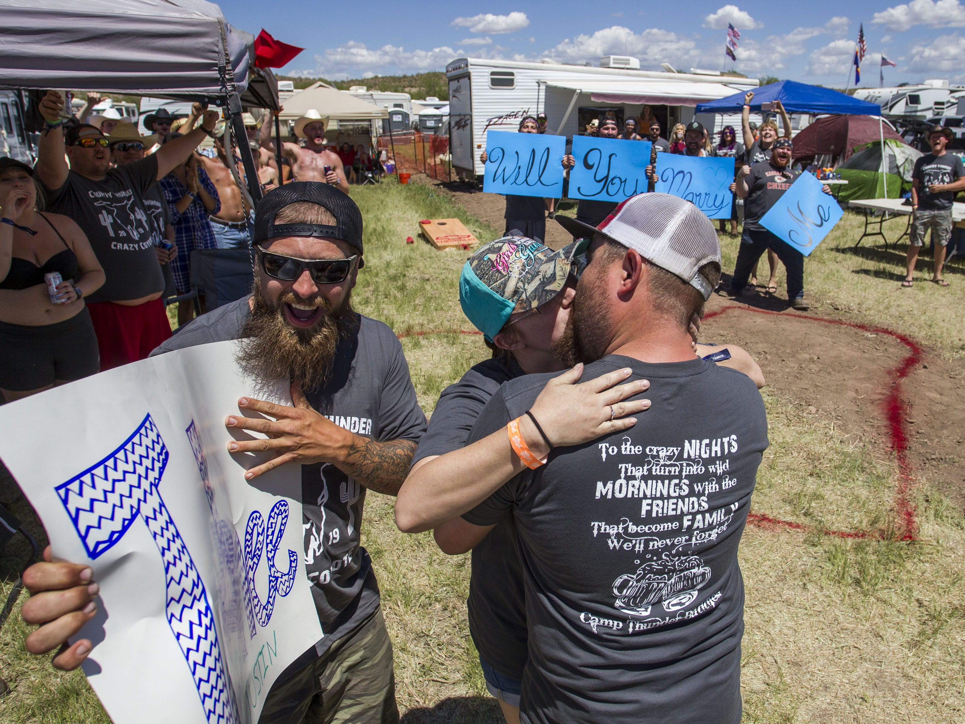 Tahnee Billingsly and Justin Adams kiss after she accepted his marriage proposal during Country Thunder Arizona Saturday, April 13, 2019, in Florence, Ariz.