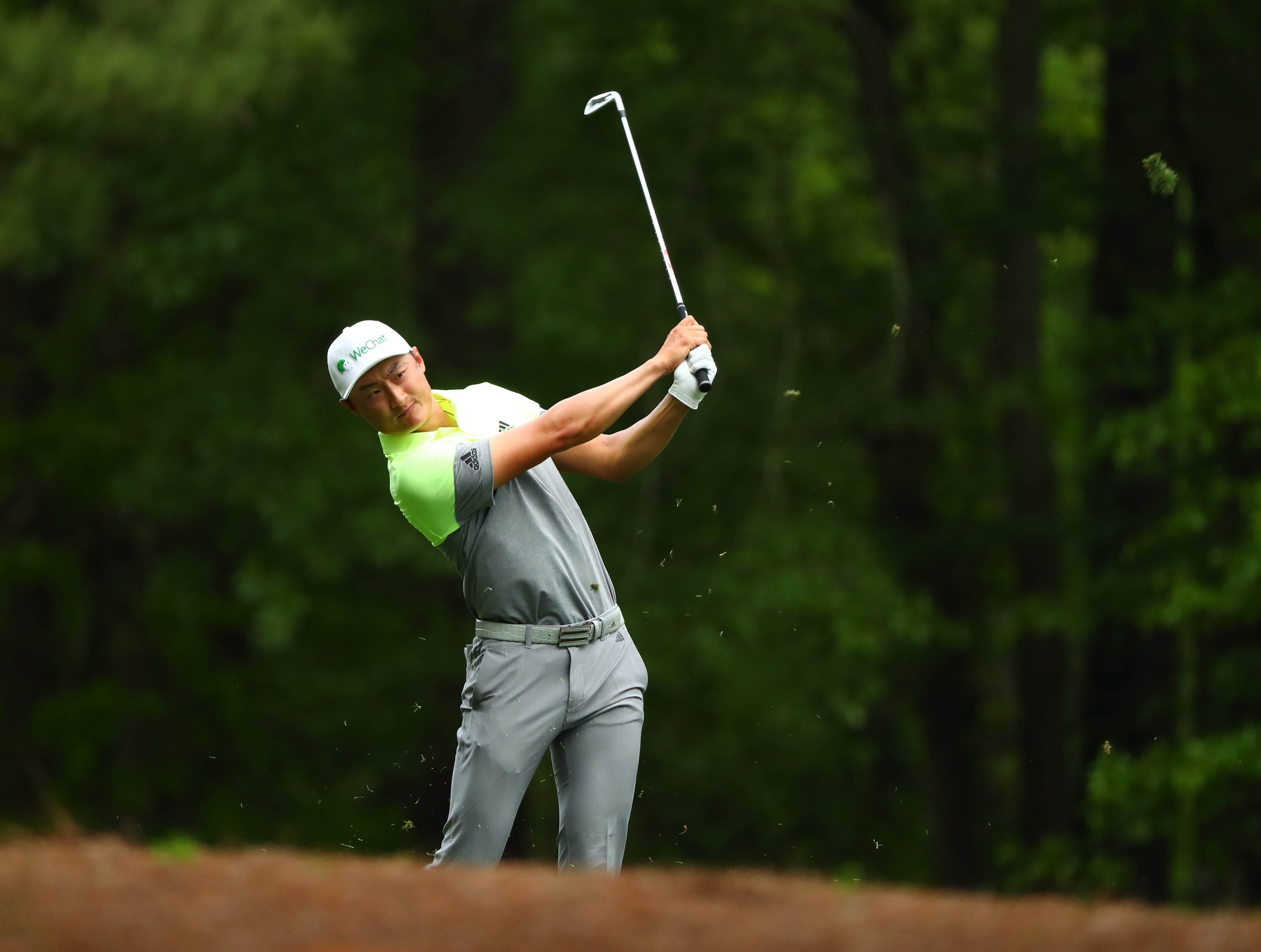 Apr 12, 2019; Augusta, GA, USA; Haotong Li plays a shot on the 11th hole during the second round of The Masters golf tournament at Augusta National Golf Club. Mandatory Credit: Rob Schumacher-USA TODAY Sports