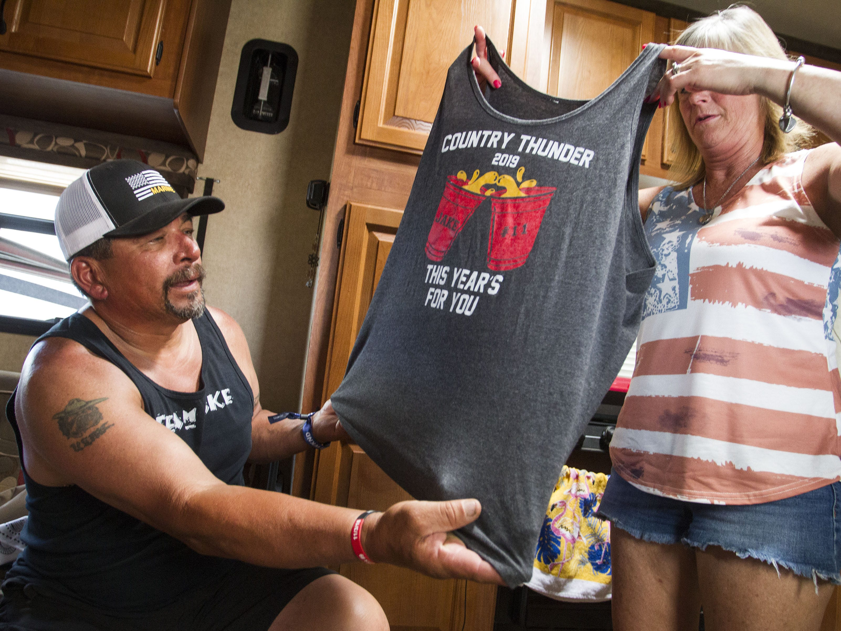 Terri and Ray Morales, of Prescott Valley, hold a shirt they designed for their son Jake after he passed unexpectedly from Fentanyl overdose.  The Morales were at Country Thunder  to honor Jake and his friend Gunner Bundrick.