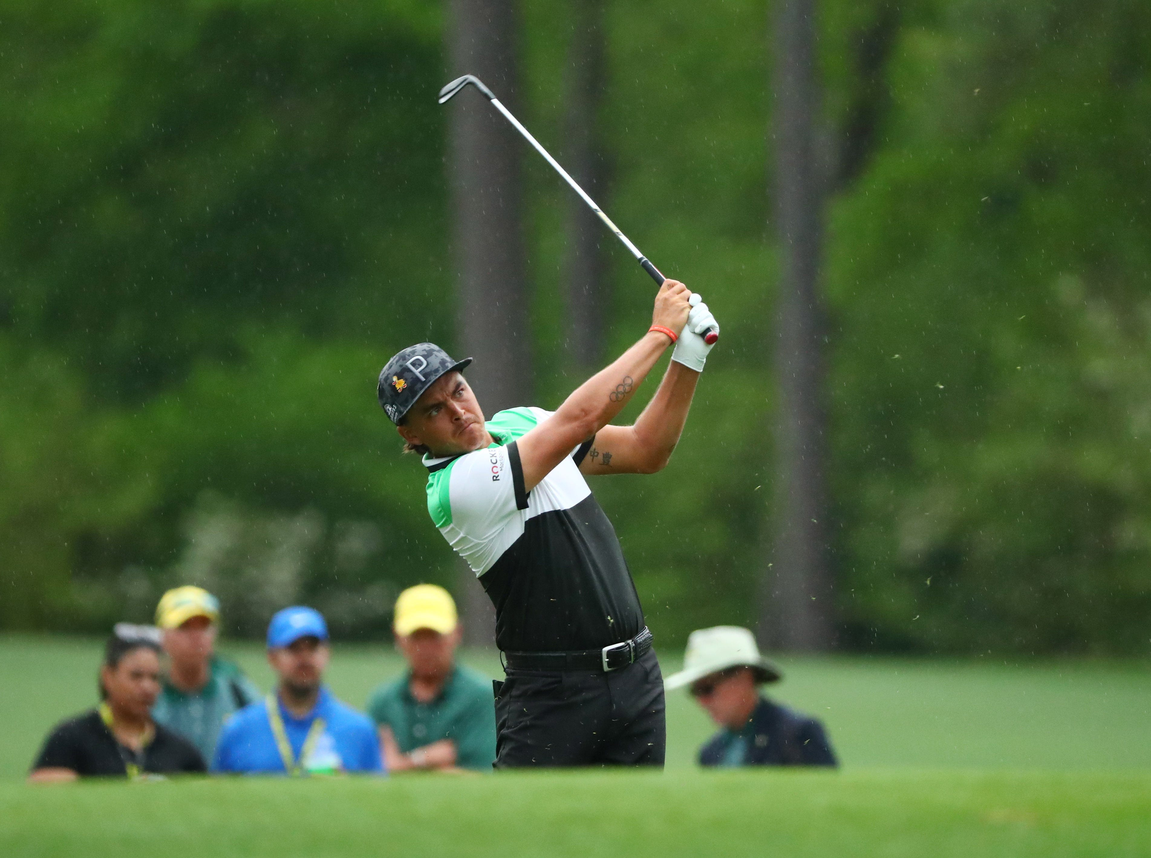 Apr 12, 2019; Augusta, GA, USA; Rickie Fowler hits his tee shot on the 12th hole during the second round of The Masters golf tournament at Augusta National Golf Club. Mandatory Credit: Rob Schumacher-USA TODAY Sports