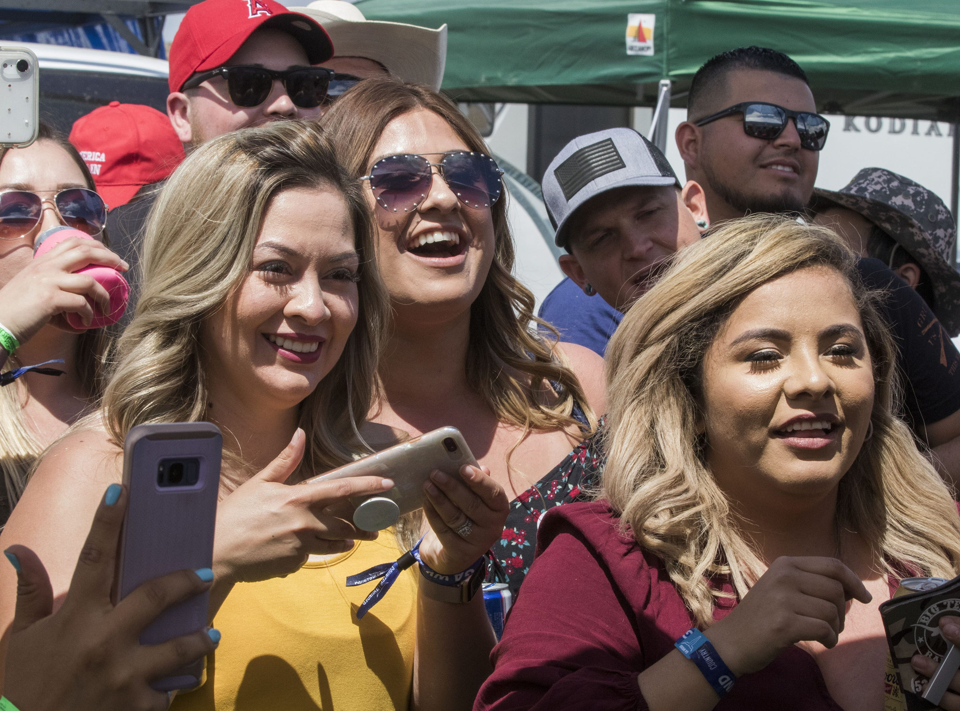 Fans cheer on their favorite Beer Olympian during the beer chugging game at Country Thunder Arizona Friday, April 12, 2019, in Florence, Arizona.