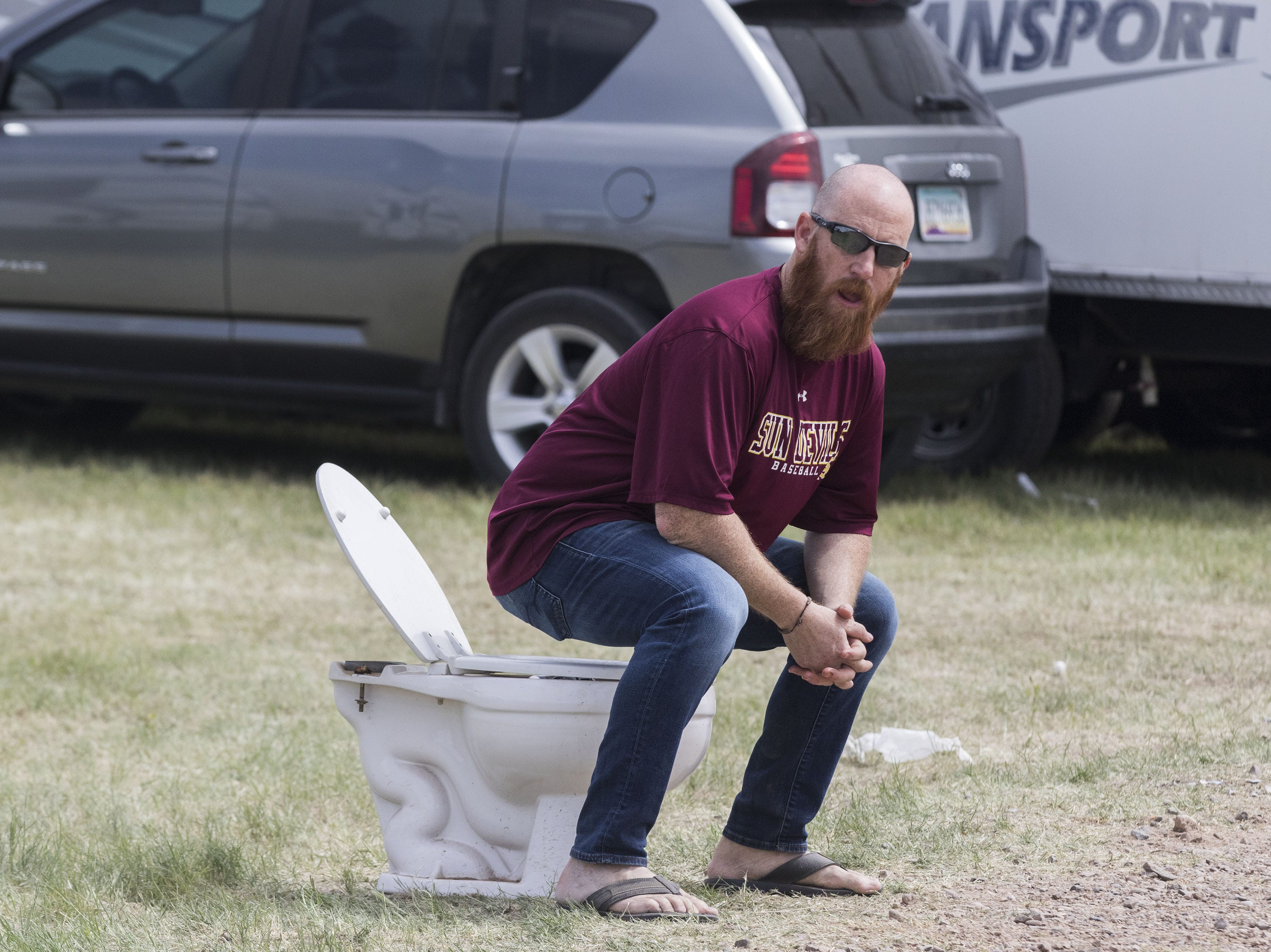 Jason Marinol of Tempe says his toliet is one of the most photographed things out at Country Thunder Arizona Friday, April 12, 2019, in Florence, Arizona.  Marinol said people are always stopping and taking photos his toilet filled with beer cans.