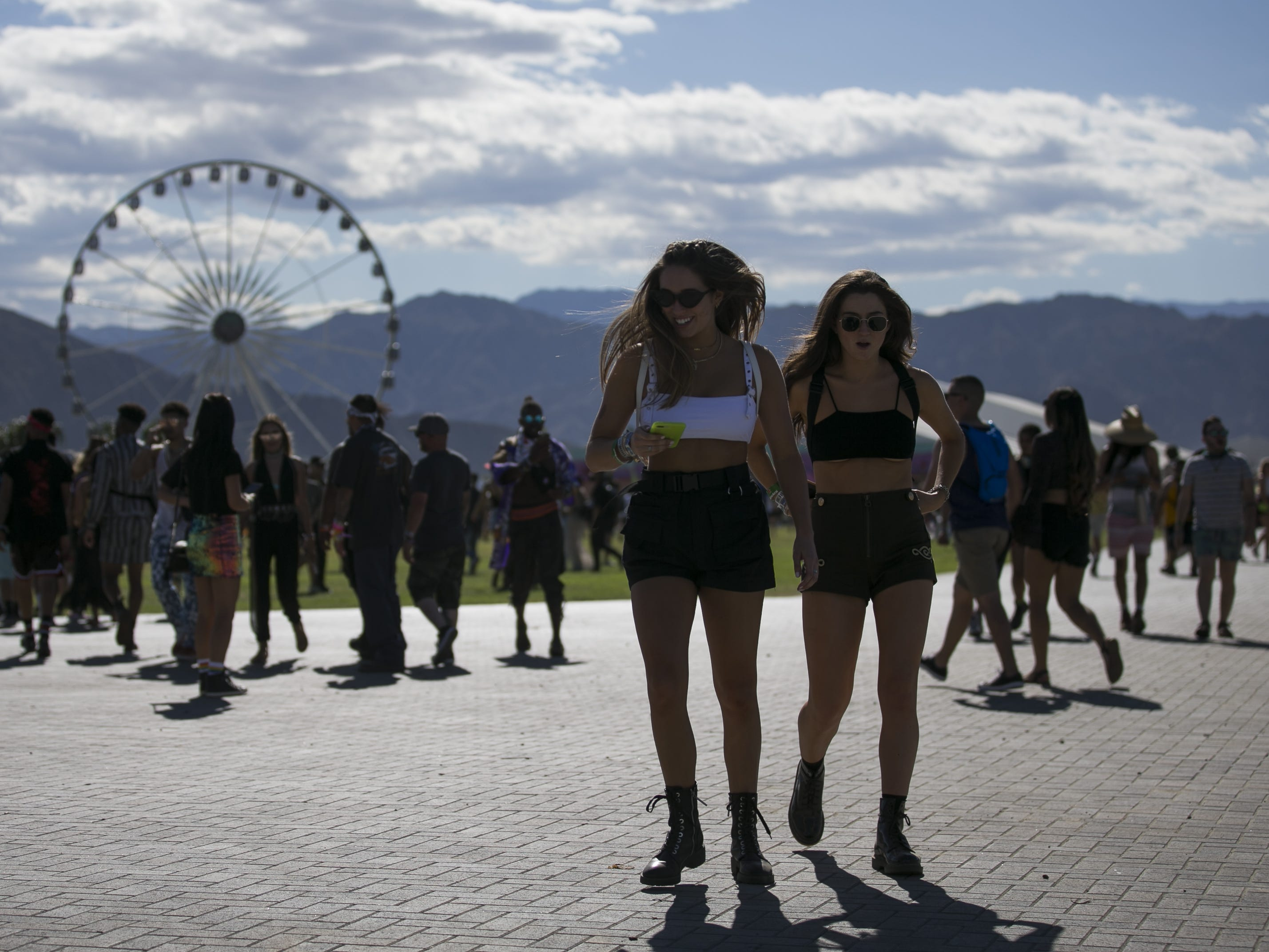 Shelby Silva (right) and Anna Arnett (left) walk through the grounds at the Coachella Valley Music and Arts Festival in Indio, Calif. on April 12, 2019.