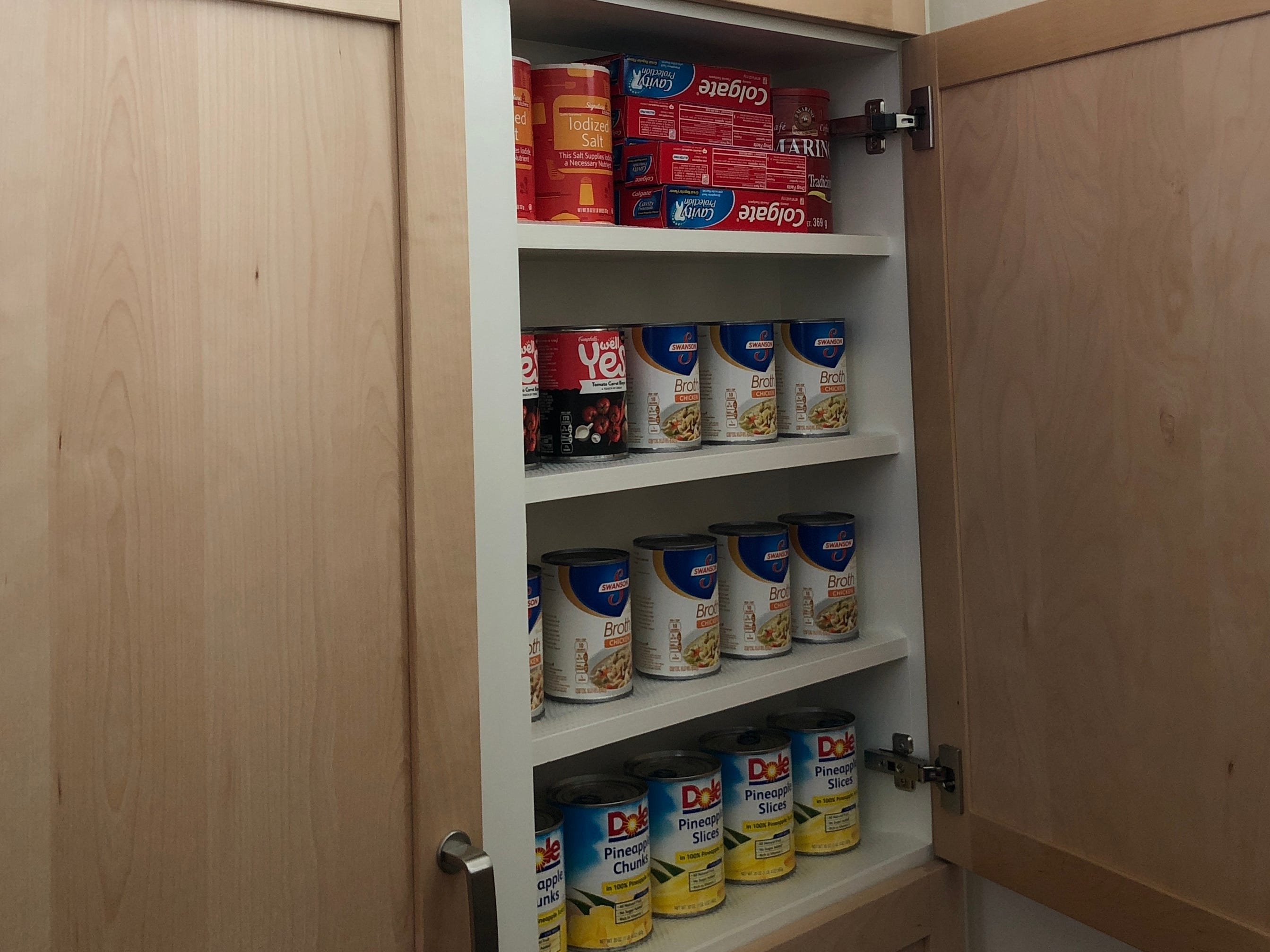 The pantry shelves make efficient use of a small, narrow space by being one-can deep.