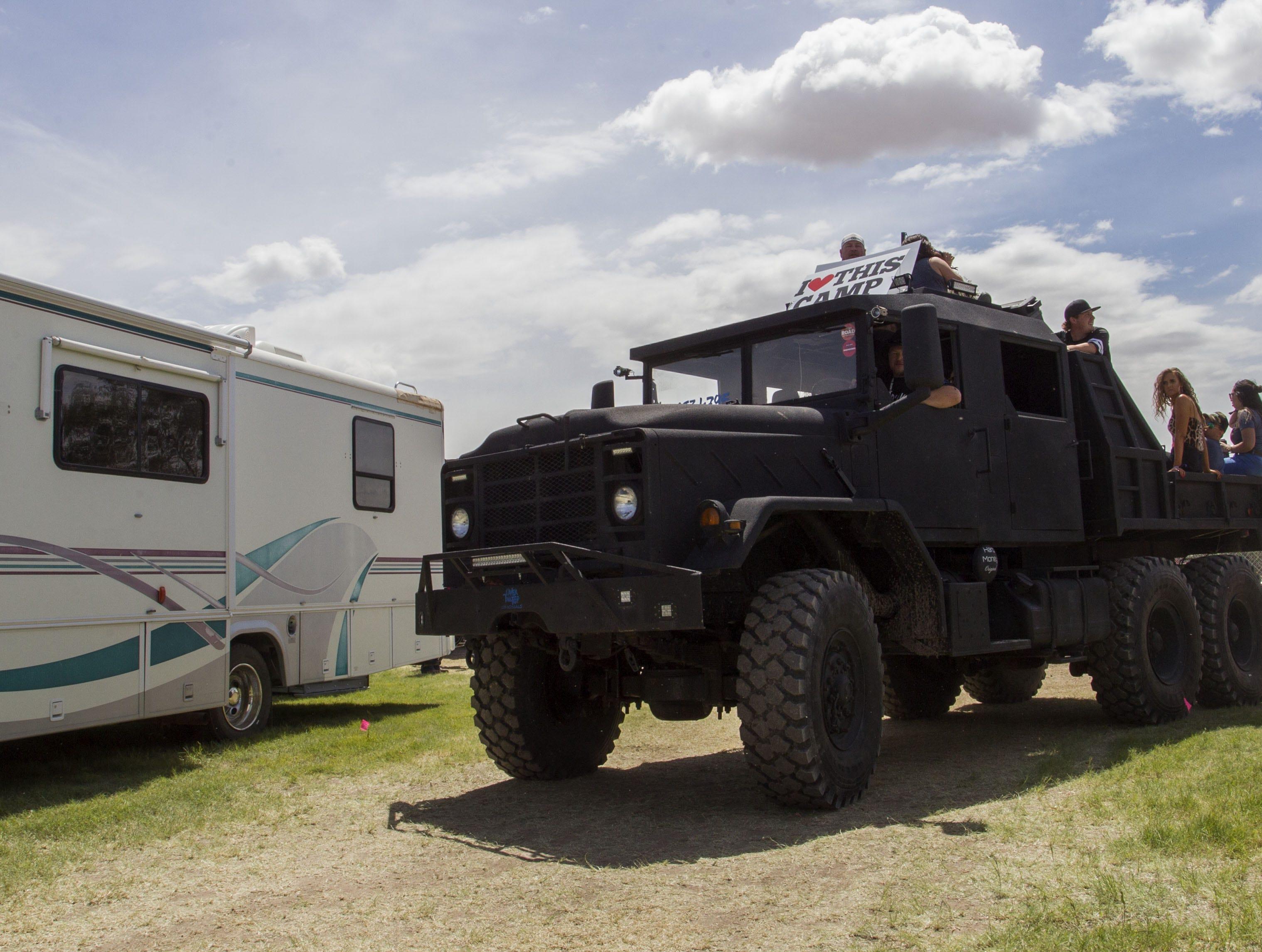 I Love this Camp's big truck hauls concert-goers around Country Thunder Arizona Friday, April 12, 2019, in Florence, Arizona.