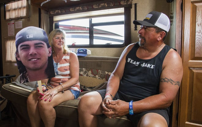 Terri Morales holds a photo of her son, Jake, as she and her husband, Ray, of Prescott Valley, talk about the unexpected death of their son who loved Country Thunder Arizona on Saturday, April 13, 2019, in Florence, Ariz. The Morales were at Country Thunder to honor Jake and his friend Gunner Bundrick.