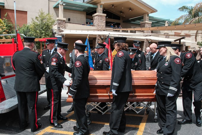 The casket is carried out at the funeral for Mesa firefighter Nikki Sullivan at Sun Valley Community Church in Gilbert on April 12, 2019.