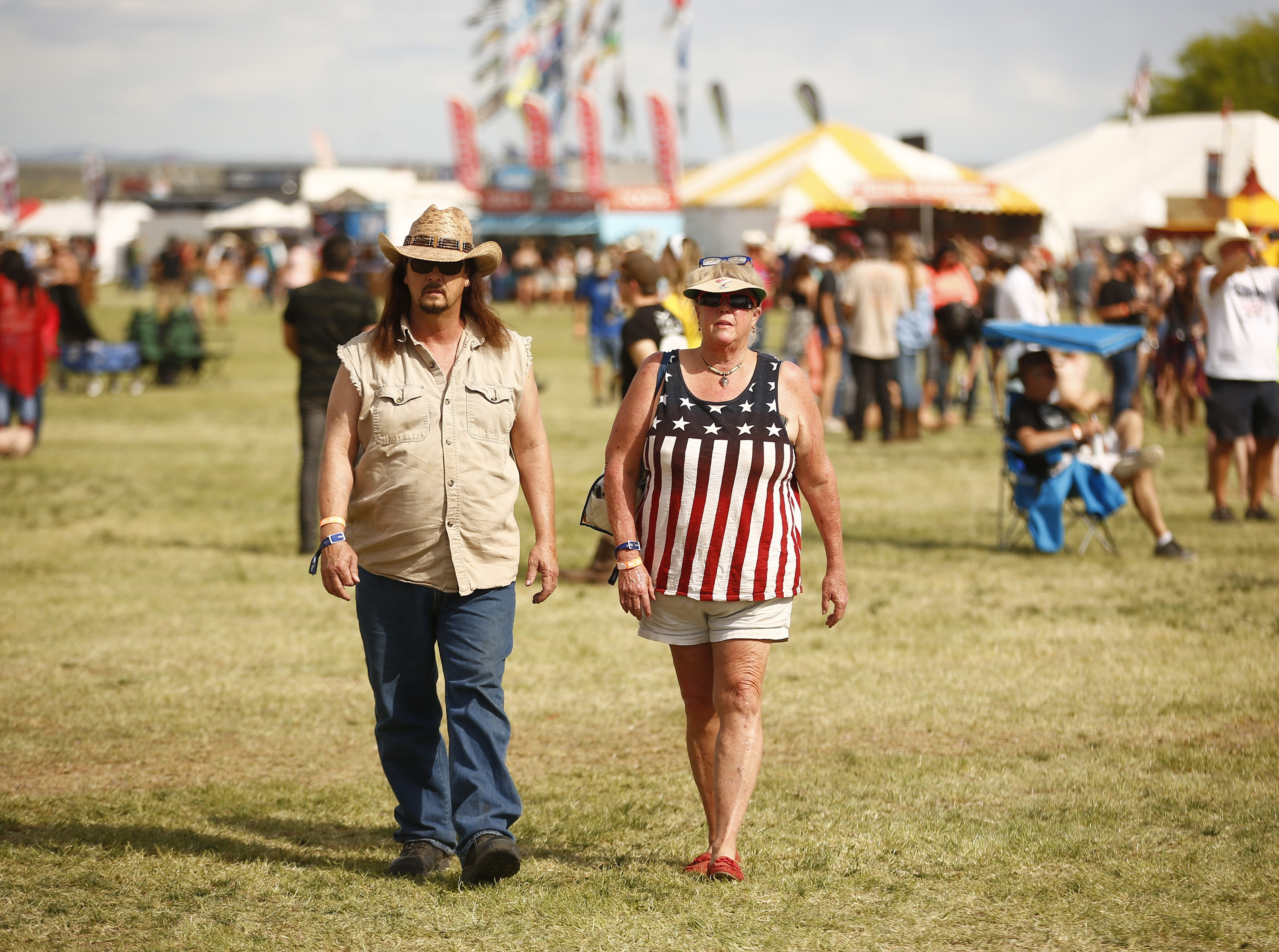 Fans make their way toward the main stage during Country Thunder in Florence, Ariz., on Friday, April 12, 2019.