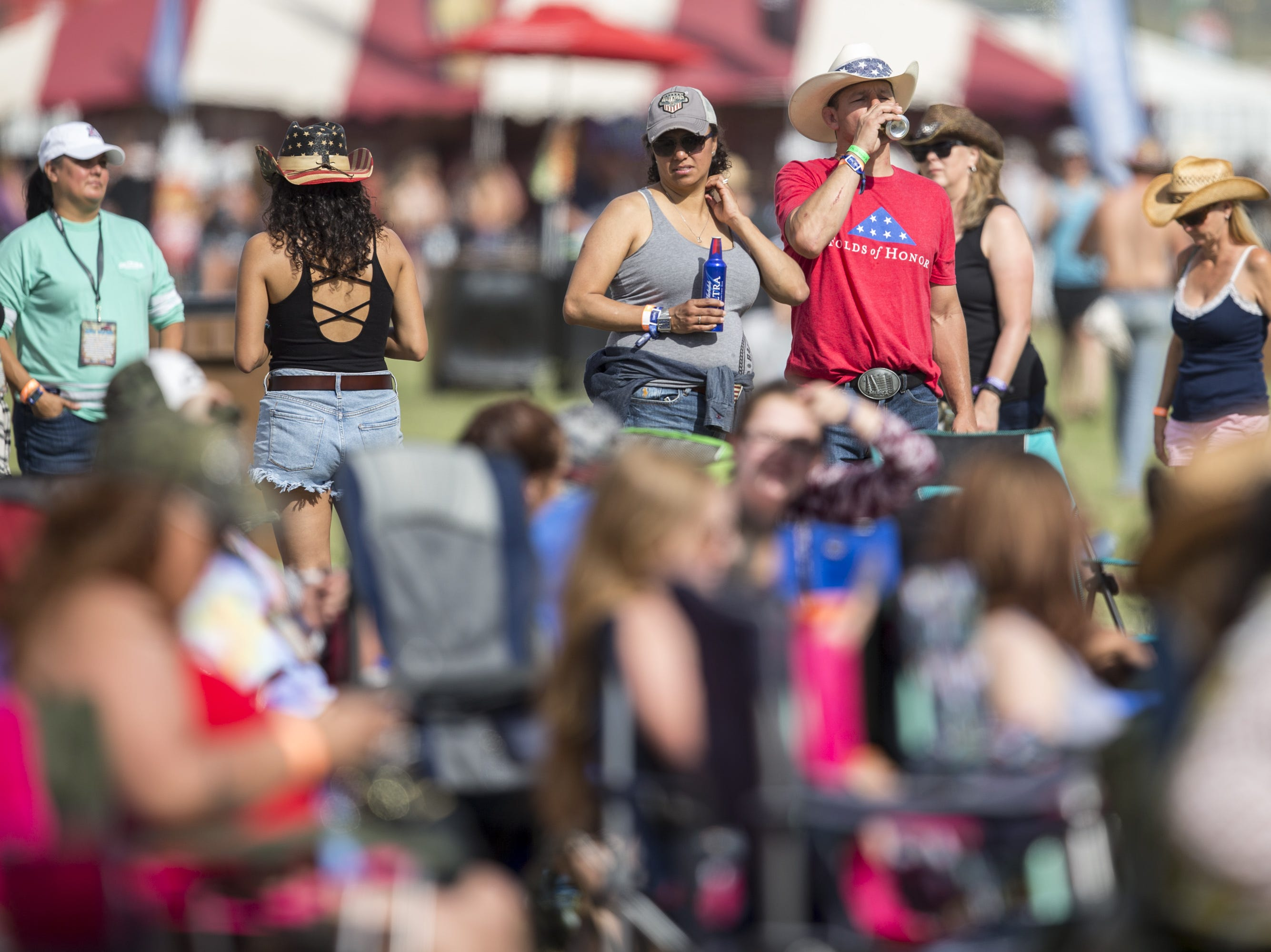 Fans watch Abby Anderson perform on Friday, April 12, 2019, during Day 2 of Country Thunder Arizona in Florence, Ariz.