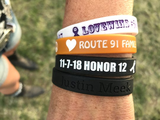 Laura Lynn Meek wears wristbands to honor the victims of the 2017 Las Vegas mass shooting, and the victims of the Nov. 7, 2018, mass shooting at Borderline Bar and Grill in Thousand Oaks, California. Her son, Justin Allen Meek, was killed in the Borderline shooting.