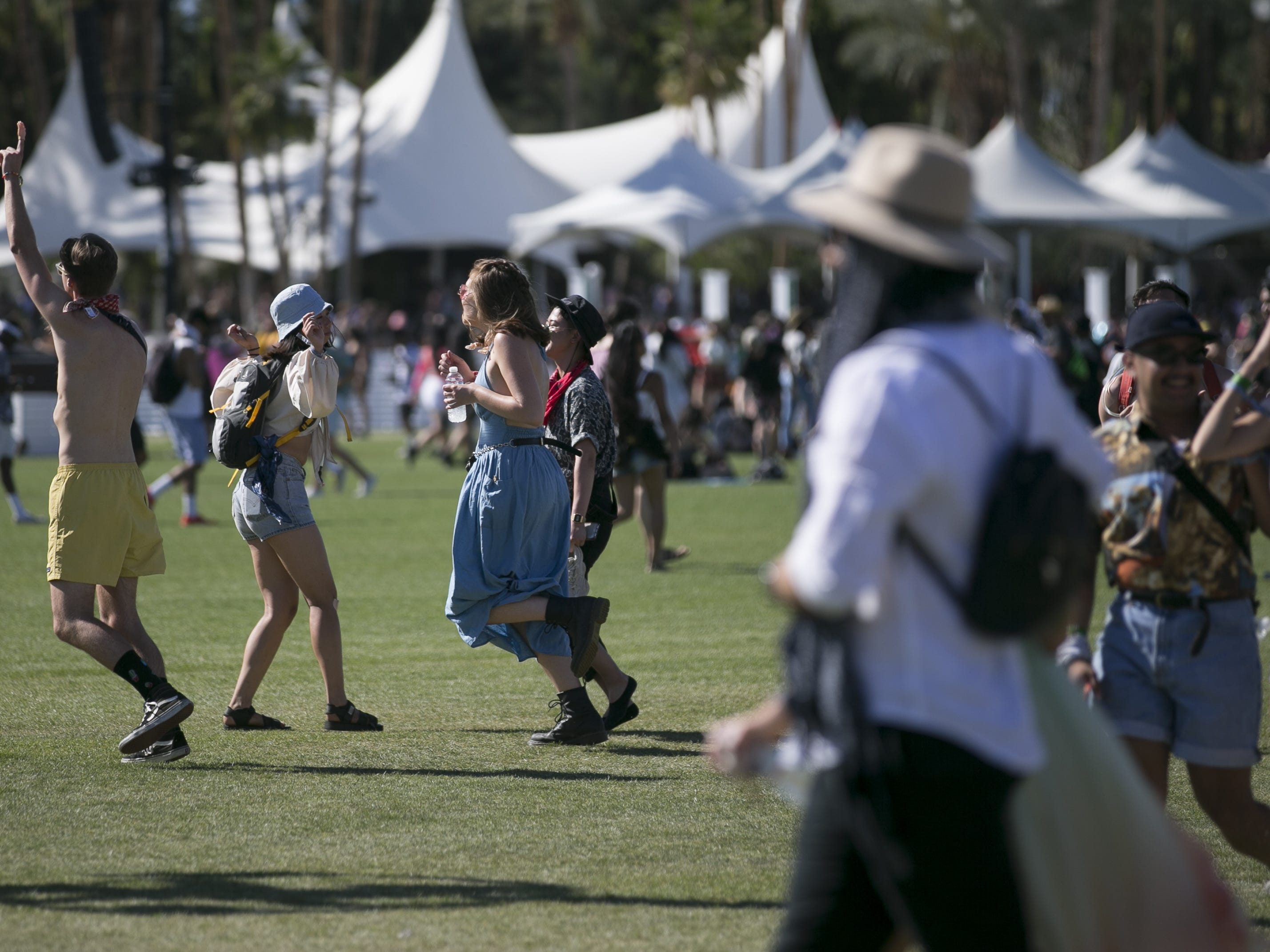Festival-goers walk through the festival grounds at the Coachella Valley Music and Arts Festival in Indio, Calif. on April 12, 2019.