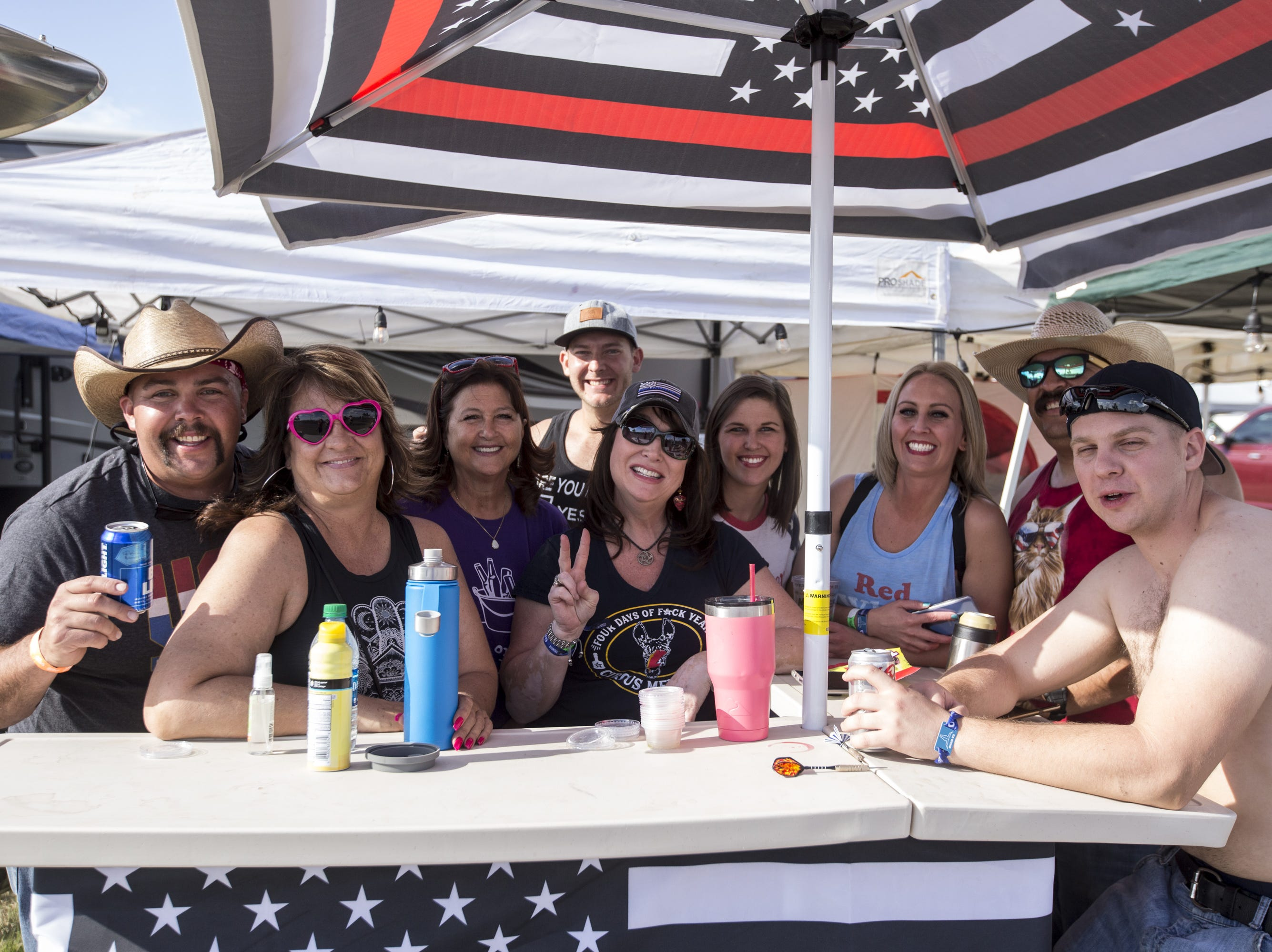 Festival-goers pose for a portrait on Friday, April 12, 2019, during Day 2 of Country Thunder Arizona in Florence, Ariz.
