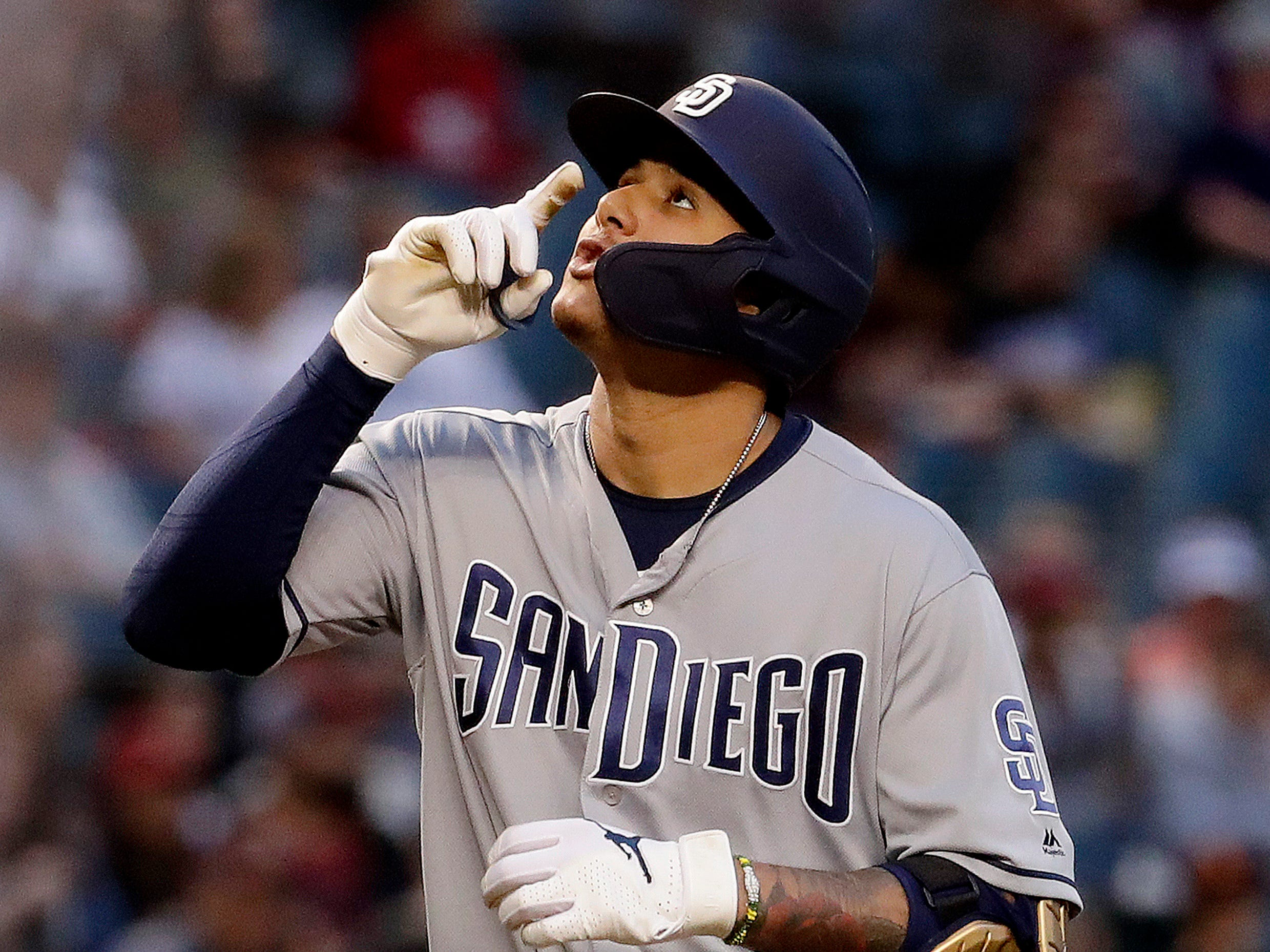 San Diego Padres' Manny Machado celebrates his solo home run against the Arizona Diamondbacks during the first inning of a baseball game Friday, April 12, 2019, in Phoenix. (AP Photo/Matt York)