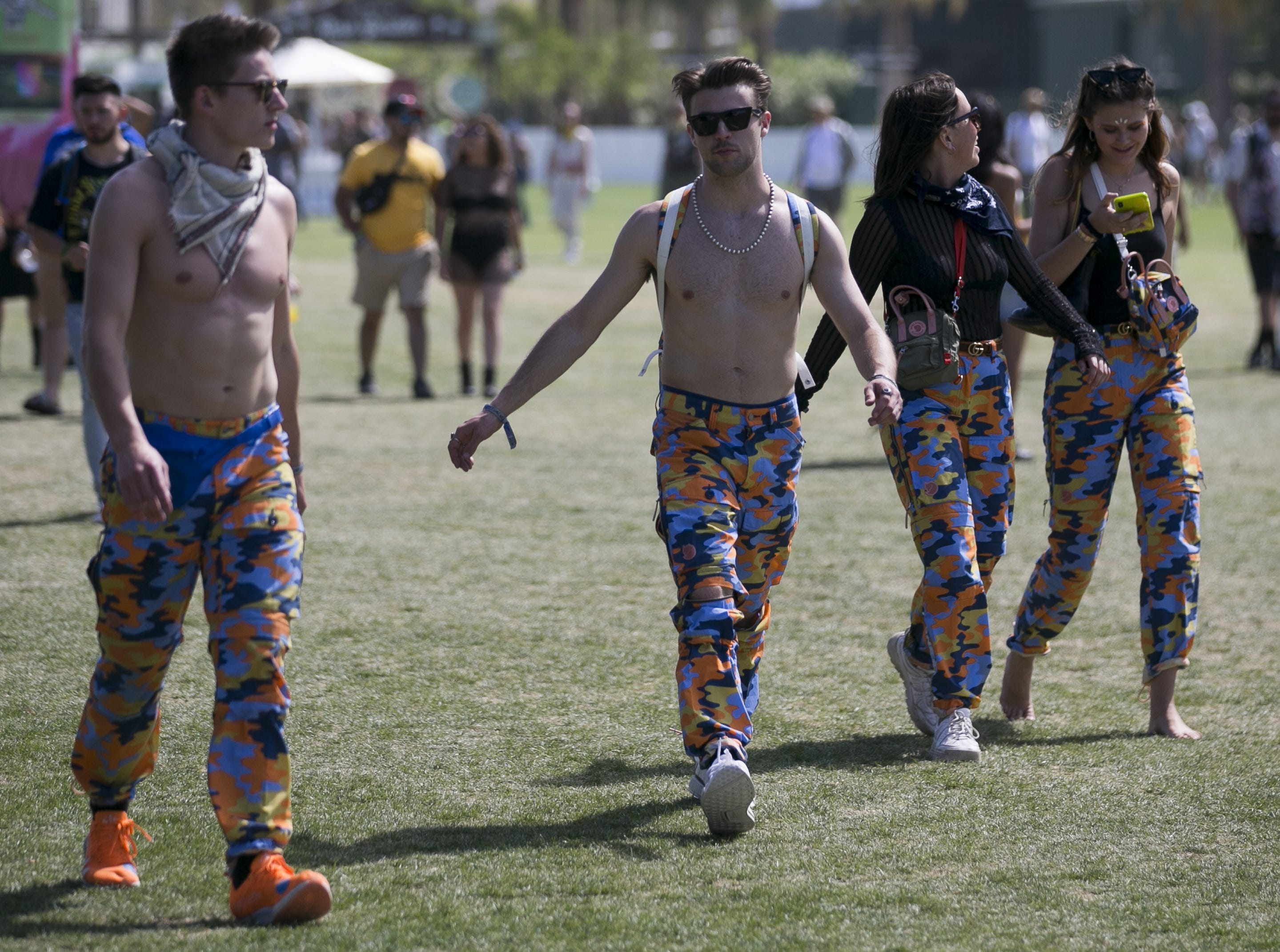 Festival goers walk through the festival grounds at the Coachella Valley Music and Arts Festival in Indio, Calif. on Fri. April 12, 2019.