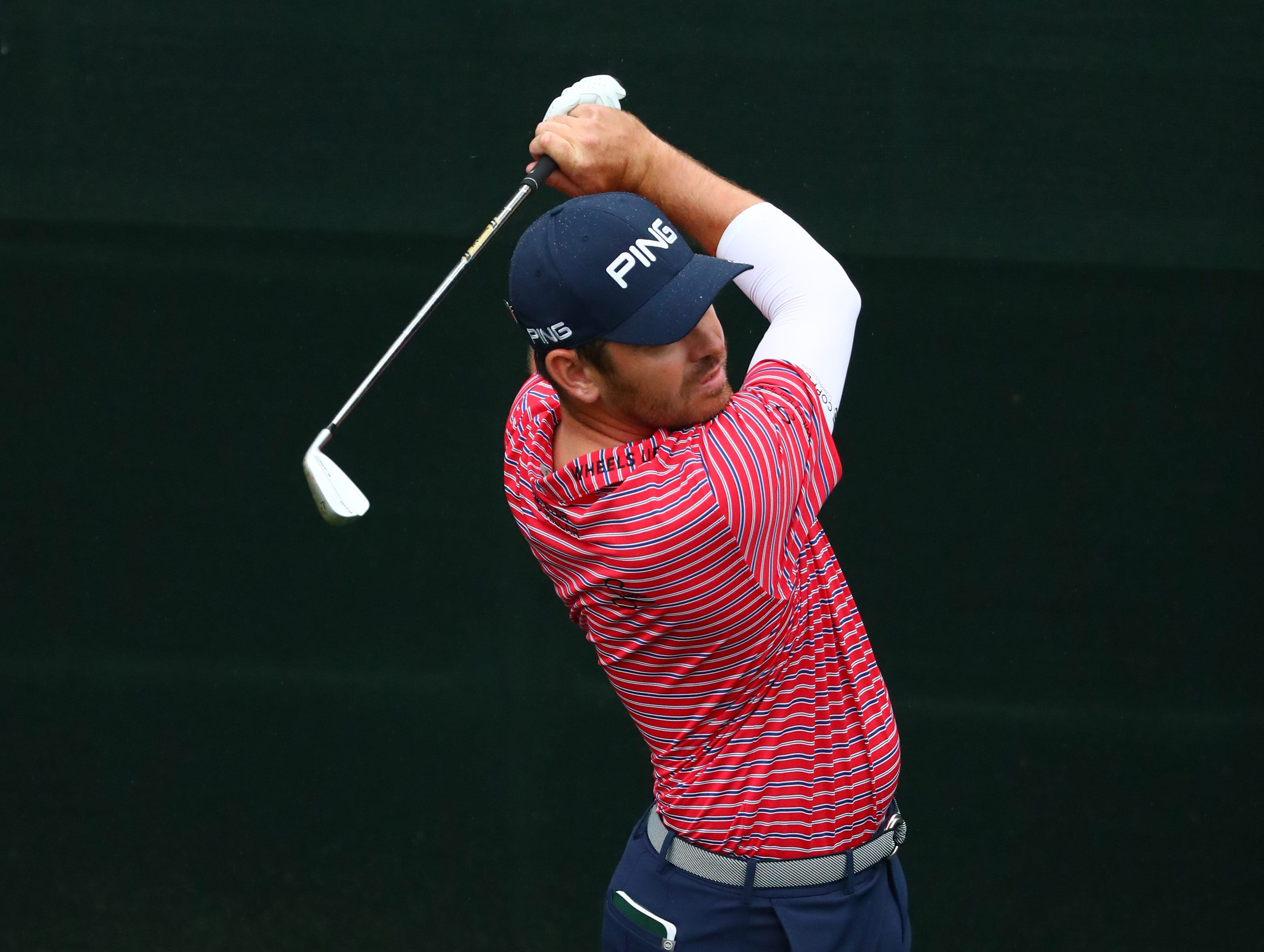 Apr 12, 2019; Augusta, GA, USA; Louis Oosthuizen hits his tee shot on the 16th hole during the second round of The Masters golf tournament at Augusta National Golf Club. Mandatory Credit: Rob Schumacher-USA TODAY Sports